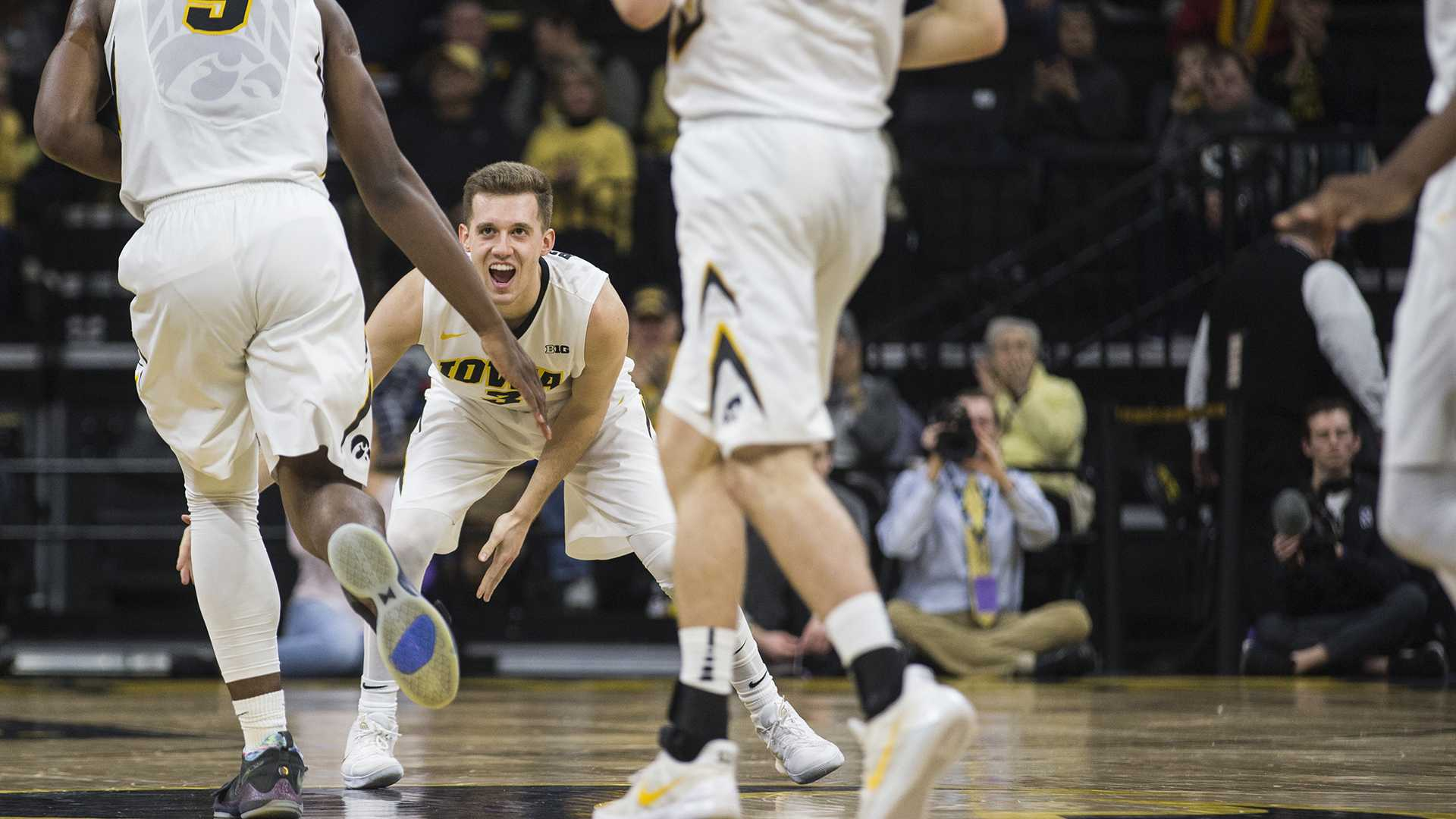Iowa senior Jordan Bohannon (3) celebrates a made shot during the first half of the Senior Day men's basketball game between Iowa and Northwestern at Carver-Hawkeye Arena on Sunday, Feb. 25, 2018. The Hawkeyes defeated the Wildcats 77-70. (Ben Allan Smith/The Daily Iowan)