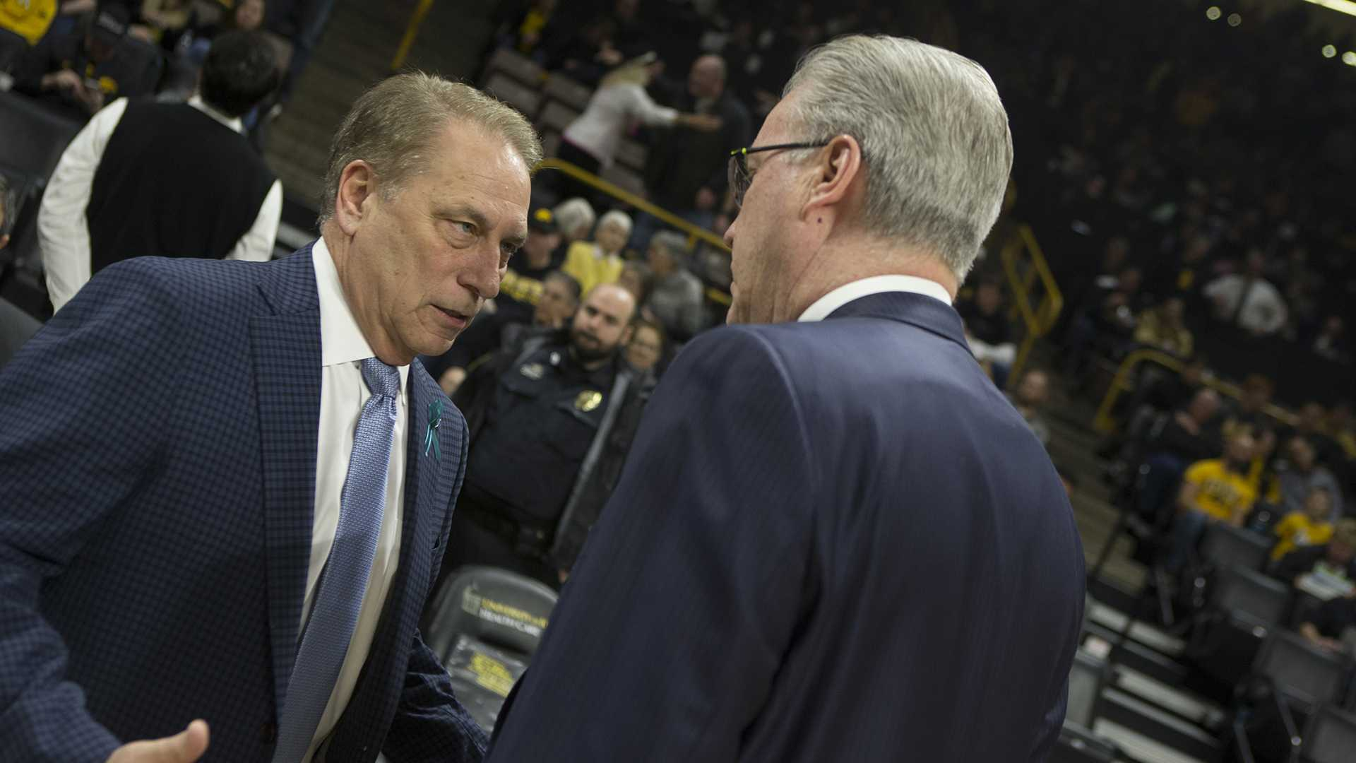 Iowa head coach Fran McCaffery (right) and Michigan State head coach Tom Izzo meet before a basketball game between Iowa and Michigan State at Carver-Hawkeye Arena on Tuesday, Feb. 6, 2018. The Hawkeyes were defeated by the visiting Spartans, 96-93. (Shivansh Ahuja/The Daily Iowan)