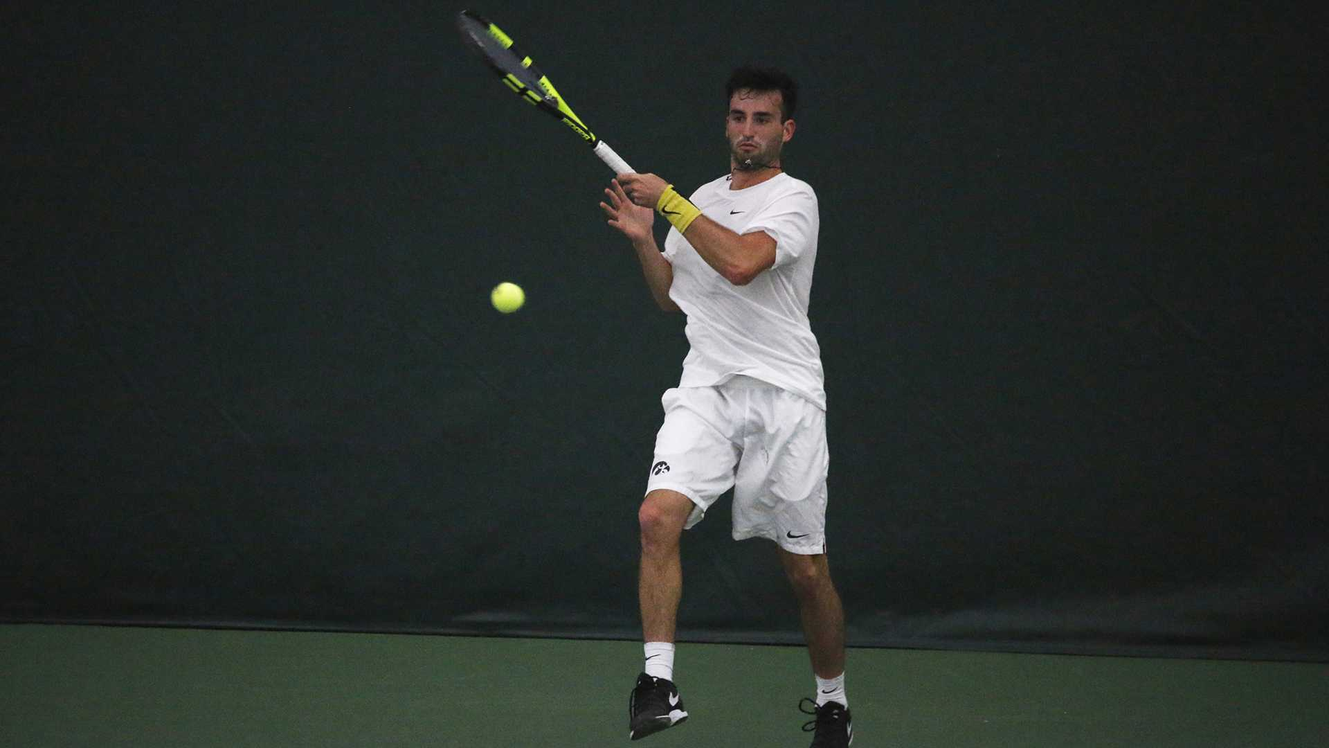 Iowa's Josh Silverstein returns the ball during the Iowa/IUPUI tennis match on Feb. 11, 2018. The Hawkeyes defeated the Jaguars 7-0. (Katina Zentz/The Daily Iowan)
