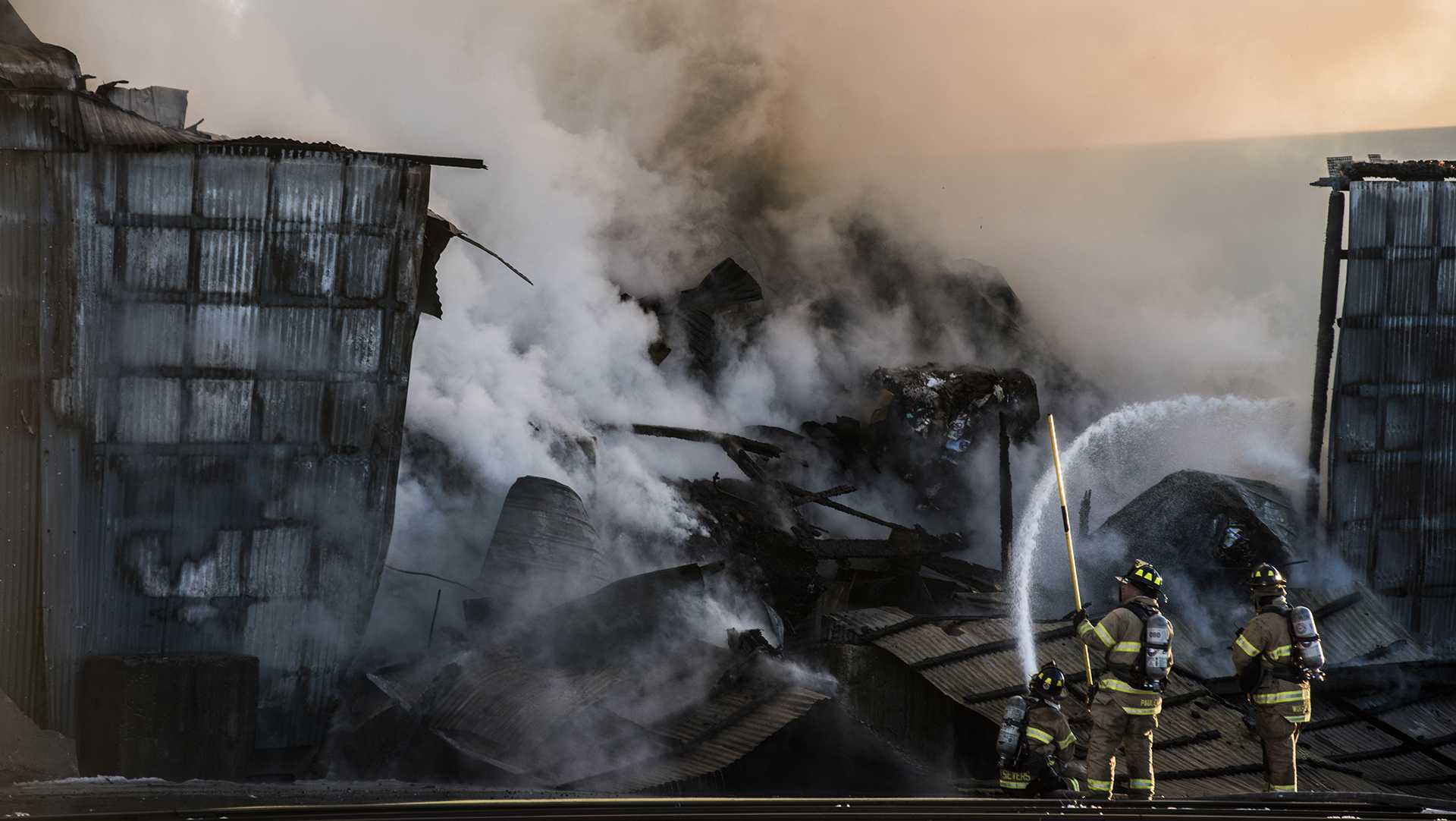 Emergency services respond to a fire at City Carton on Benton St. around 5 p.m. on Friday, Feb. 16,  2018. (Ben Allan Smith/The Daily Iowan)
