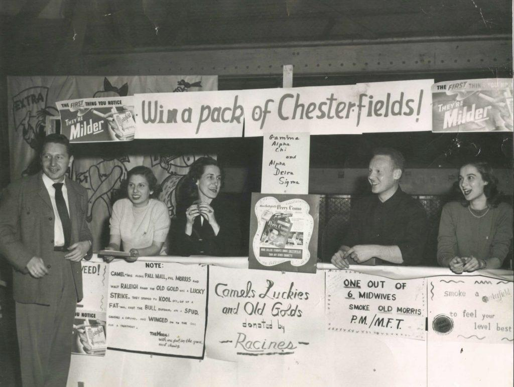 Harold Arkoff (left) and other Daily Iowan advertising students hang out at the University of Iowa's carnival in 1949. Arkoff served as the DI's business manager nearly 70 years ago and now lives in California. (Contributed)