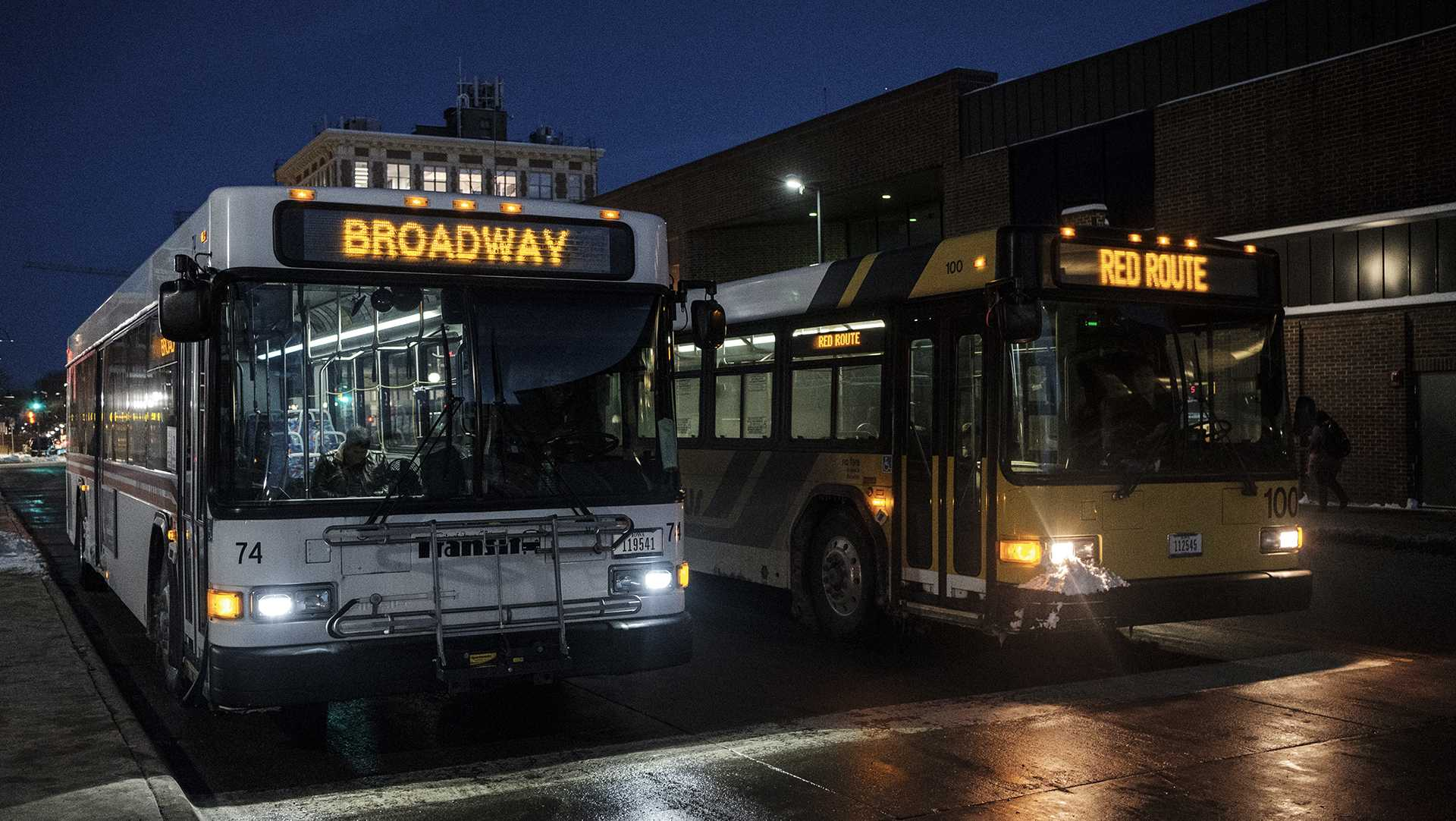 Commuters load and unload busses at the Downtown interchange in Iowa City on Wednesday, Feb. 7, 2018. The interchange serves routes from three different bus services: Coralville Transit, Iowa City Transit, and the University of Iowa's Cambus. Recently the Iowa City Chamber of commerce proposed greater integration of the Iowa City and Coralville bus systems. (Nick Rohlman/The Daily Iowan)