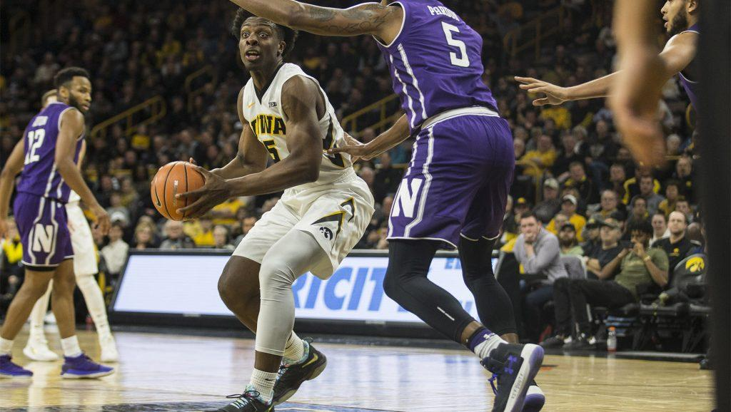 Iowa+forward+Tyler+Cook+drives+the+ball+in+the+lane+against+Northwestern%27s+Derek+Pardon+during+the+Senior+Day+men%27s+basketball+game+between+Iowa+and+Northwestern+at+Carver-Hawkeye+Arena+on+Sunday%2C+Feb.+25%2C+2018.+The+Hawkeyes+defeated+the+Wildcats+77-70.+%28Ben+Allan+Smith%2FThe+Daily+Iowan%29