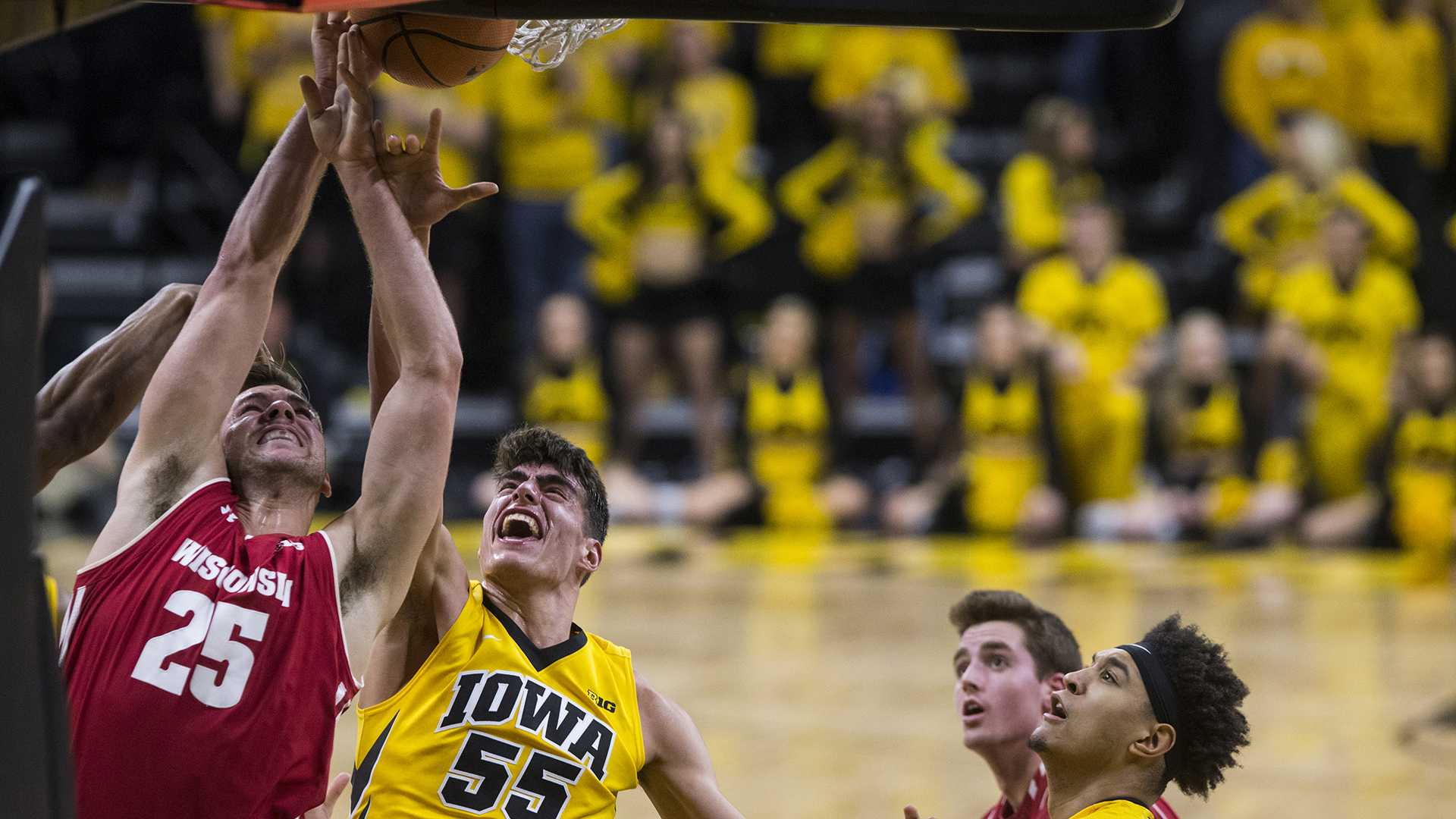 Iowa's Luka Garza (55) and Wisconsin's Alex Illikainen (25) jump for the rebound during the NCAA men's basketball game between Iowa and Wisconsin at Carver-Hawkeye Arena on Tuesday, Jan. 23, 2018. (Ben Allan Smith/The Daily Iowan)
