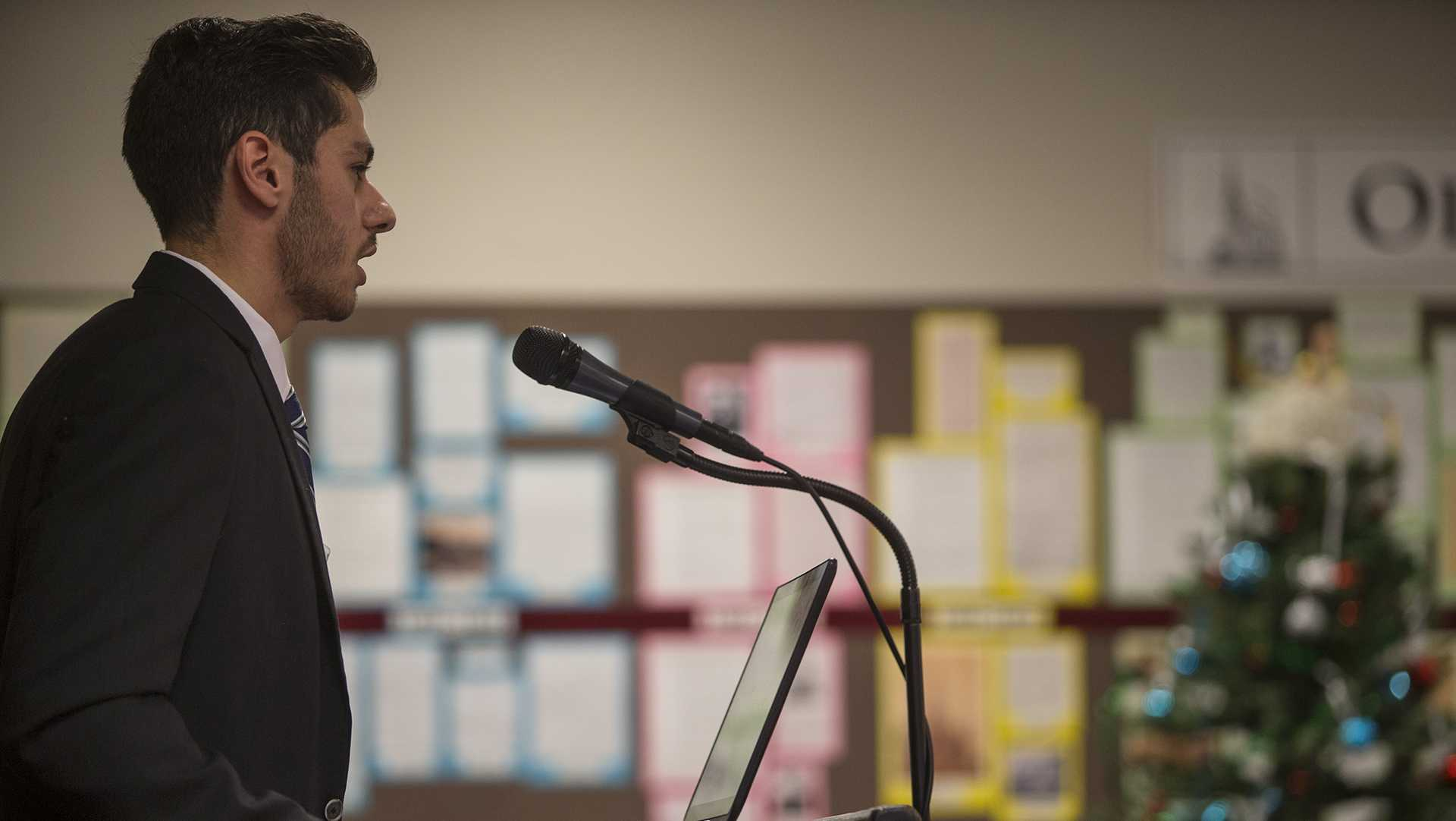 UI junior Moe Shakally speaks during a presentation for Iowa City Foreign Relations Council of his experiences as a Syrian refugee on Thursday, December 1, 2016. Shakally is an intern for the council, and he spent the summer setting up speakers and creating program brochures for the organization. (The Daily Iowan/Joseph Cress)