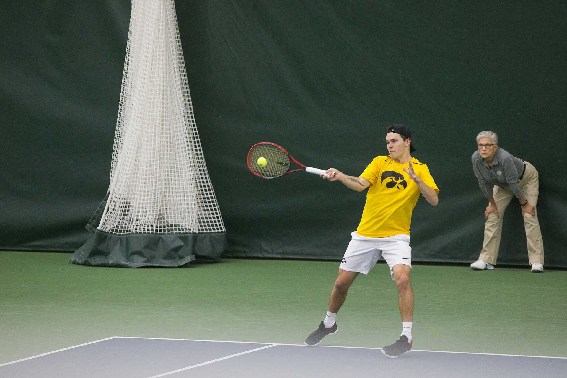 Iowa's Jonas Larsen returns a ball during the Iowa/Creighton tennis match at the Hawkeye Tennis and Recreation Complex on Friday, Feb. 16, 2018. The Hawkeyes defeated the Bluejays, 7-0. (Lily Smith/The Daily Iowan)