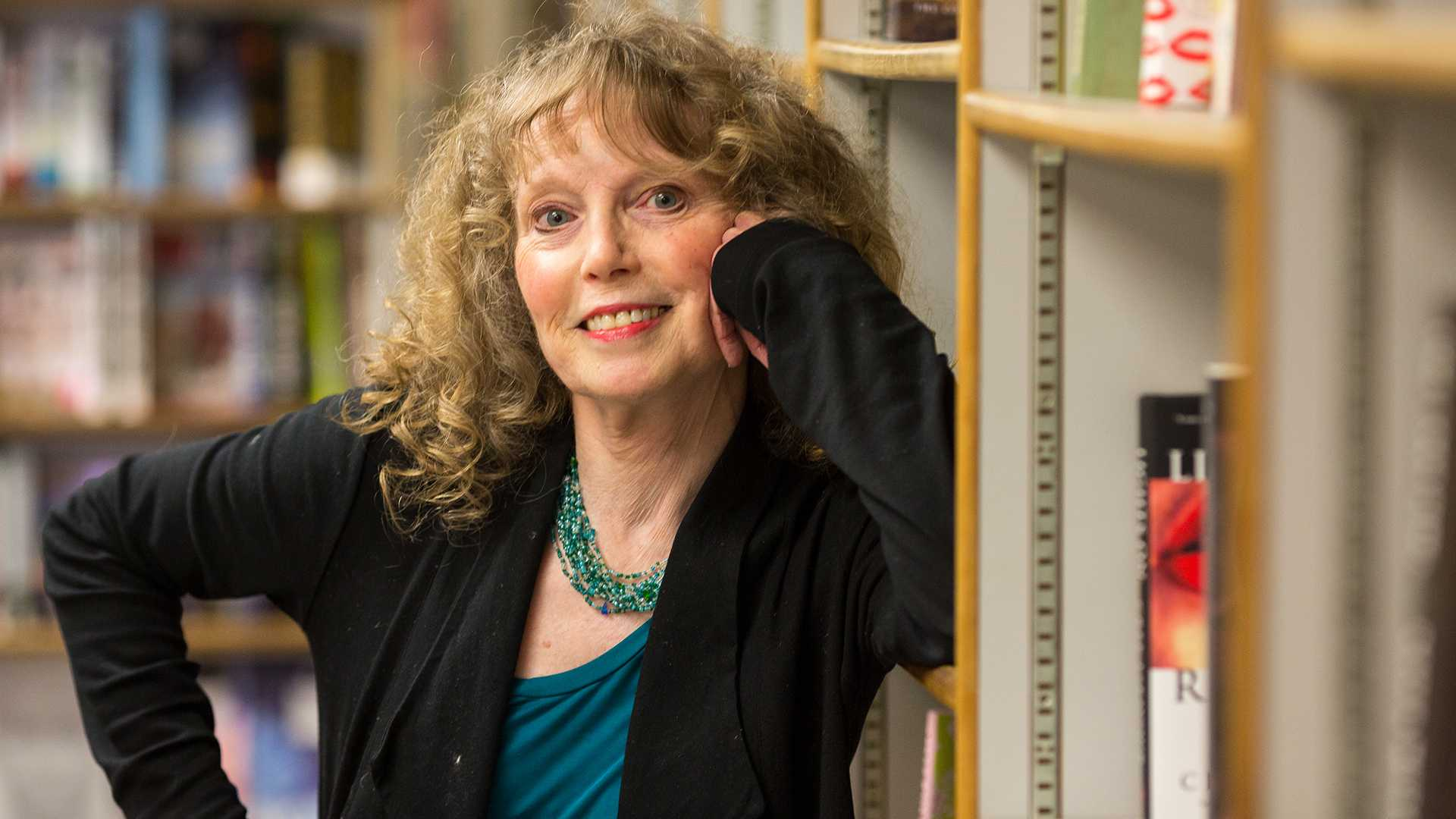 """Patricia Foster, an author and professor at the University of Iowa's Department of English, reads from her latest novel """"The Girl from Soldier Creek"""" at Prairie Lights bookstore in Iowa City on Wednesday, Feb. 28, 2018. (David Harmantas/The Daily Iowan)"""