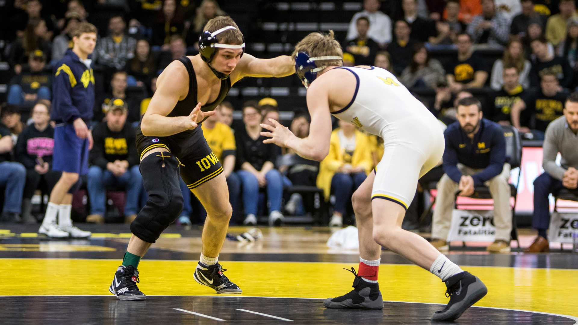 Iowa wrestler Spencer Lee grapples with Michigan wrestler Drew Martin at Carver-Hawkeye Arena on Saturday, Jan. 27, 2018. The Wolverines defeated the Hawkeyes 19-17. (David Harmantas/The Daily Iowan)