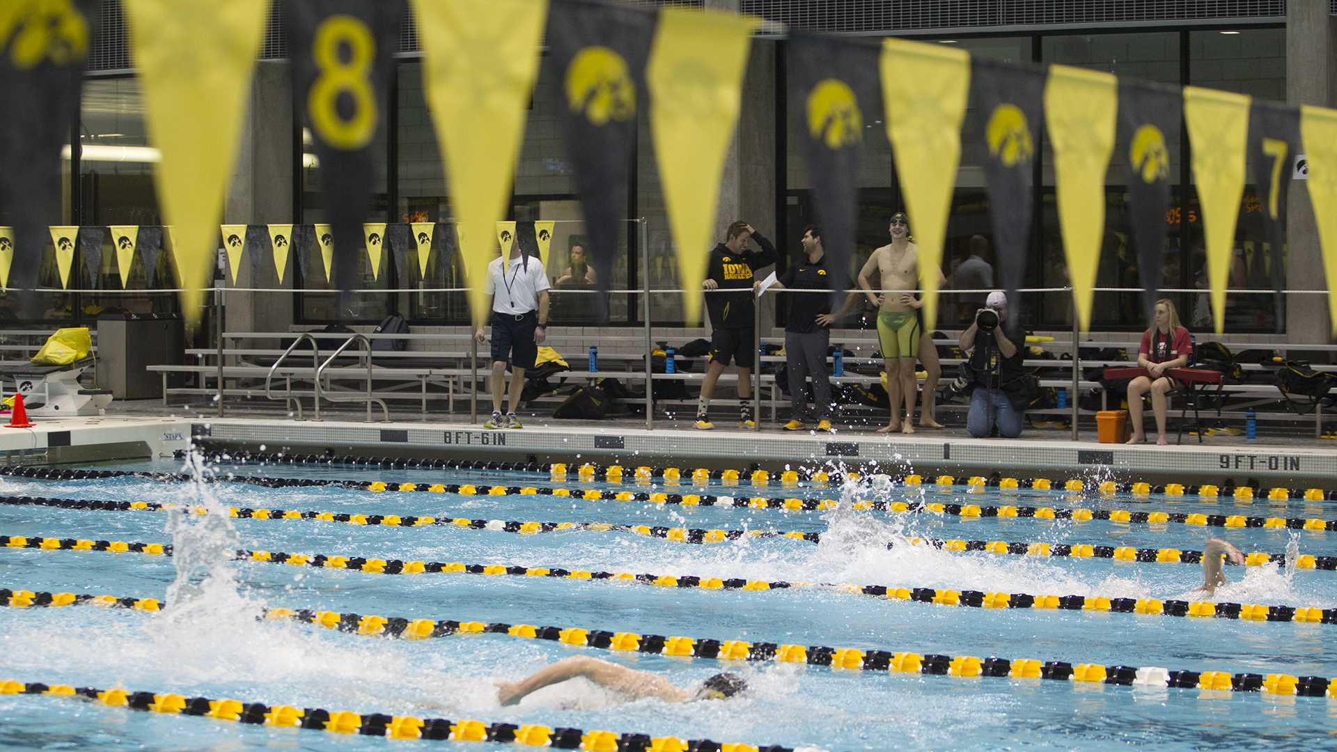 Swimmers compete in the Men's 200 freestyle during a swim meet between University of Iowa and Western Illinois on Friday, Feb. 2, 2018 at the University Aquatic Center. Swimmers competed in a variety of events including relays and freestyle swimming. (Katie Goodale/The Daily Iowan)
