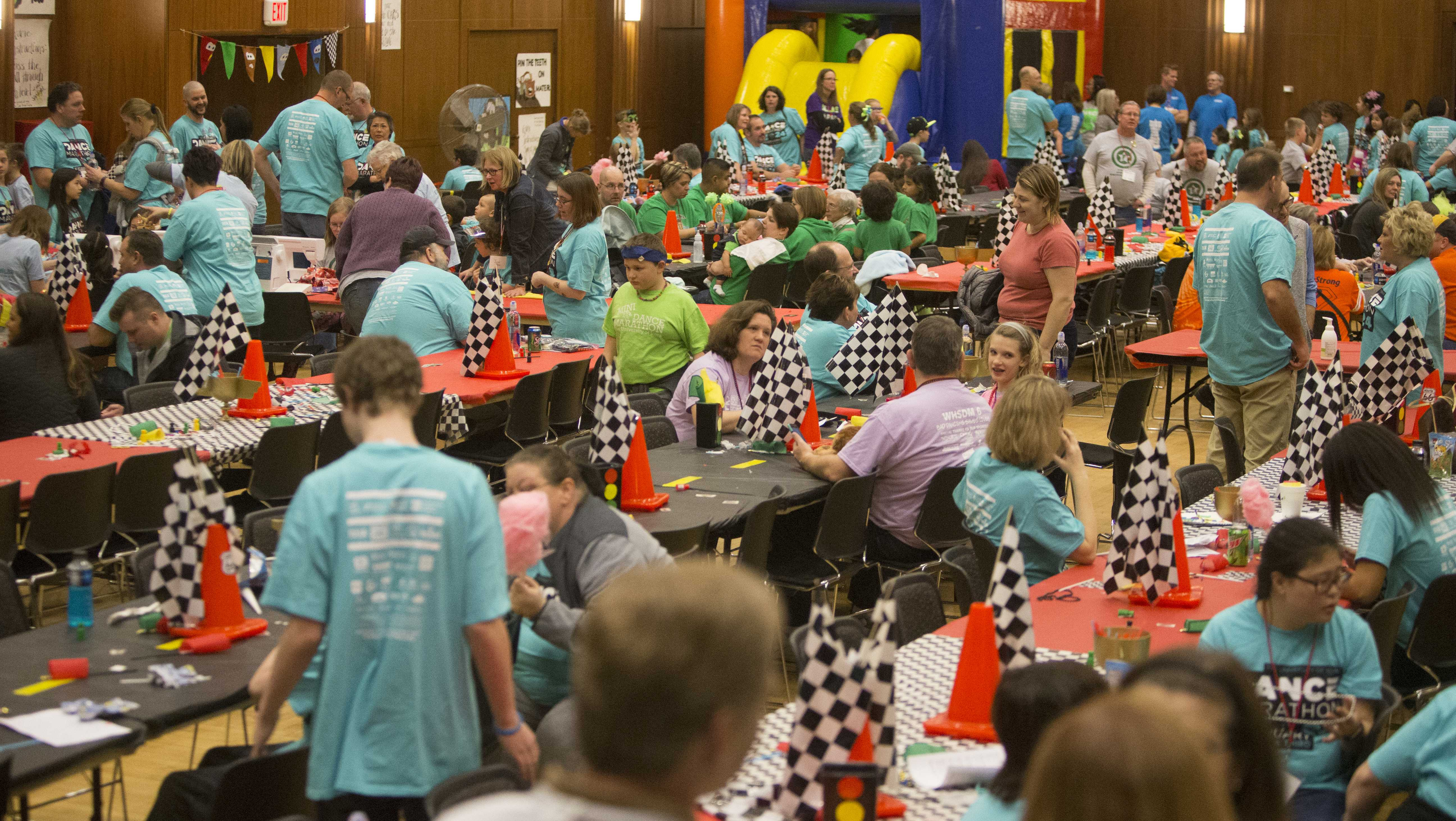 Children play at the Cars theme room in the second floor ballroom during dance Marathon 24 on Friday Feb. 2, 2018. Dance Marathon raises money for pediatric cancer research. (Katie Goodale/The Daily Iowan)