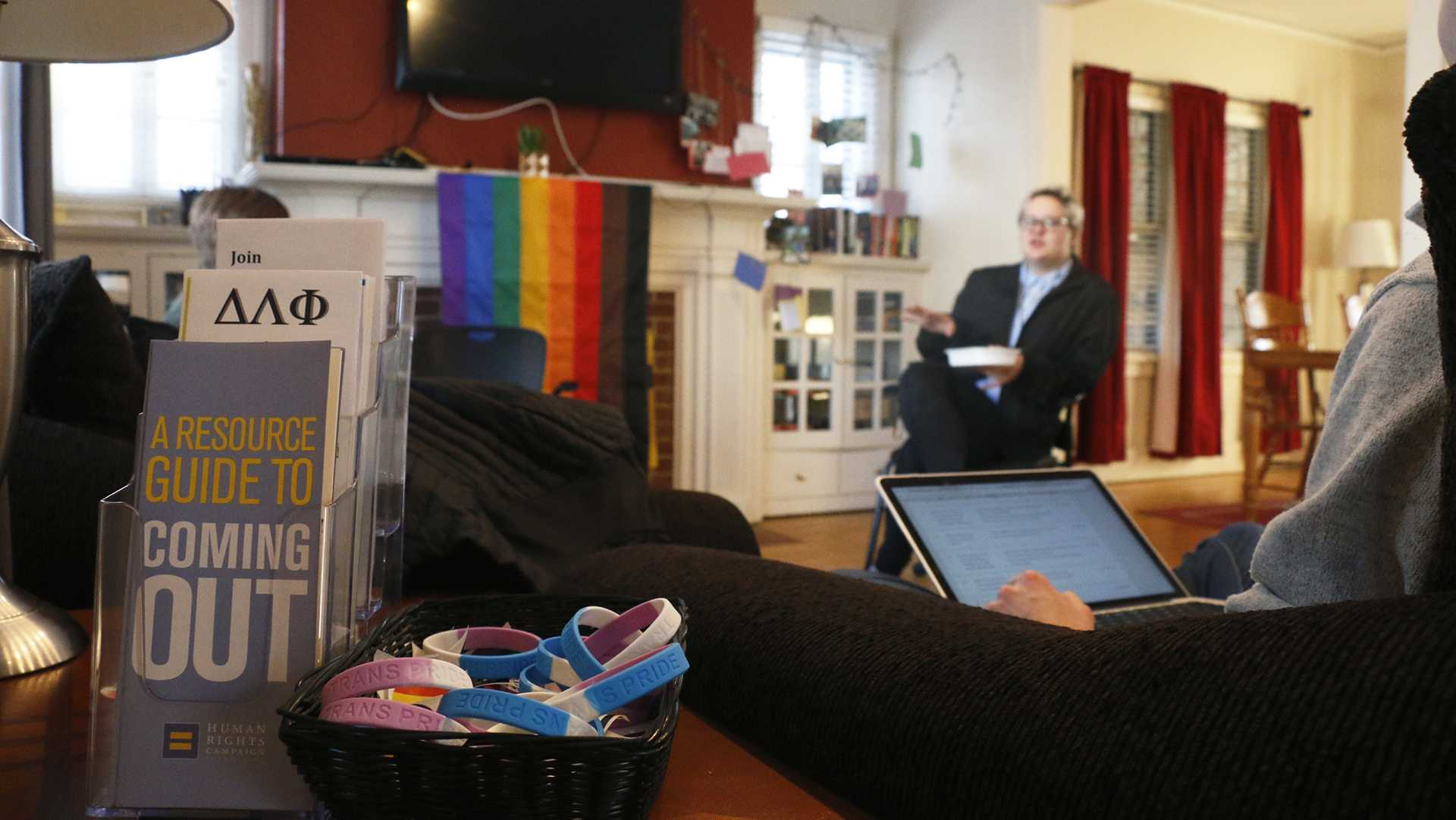 Employees discuss issues concerning the LGBT community in the UI LGBT Resource Center on Feb. 7, 2018. Representatives from Student Legal Services, the UI LGBT Clinic, and Student Health Services spoke about the resources that would available to trans individuals on campus. (Katina Zentz/The Daily Iowan)