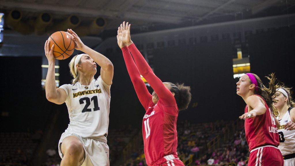 Iowa+forward+Hannah+Stewart+attempts+a+shot+during+the+Iowa%2FWisconsin+basketball+game+at+Carver-Hawkeye+Arena+on+Sunday%2C+Feb.+18%2C+2018.+The+Hawkeyes+defeated+the+Badgers%2C+88-61.+%28Lily+Smith%2FThe+Daily+Iowan%29