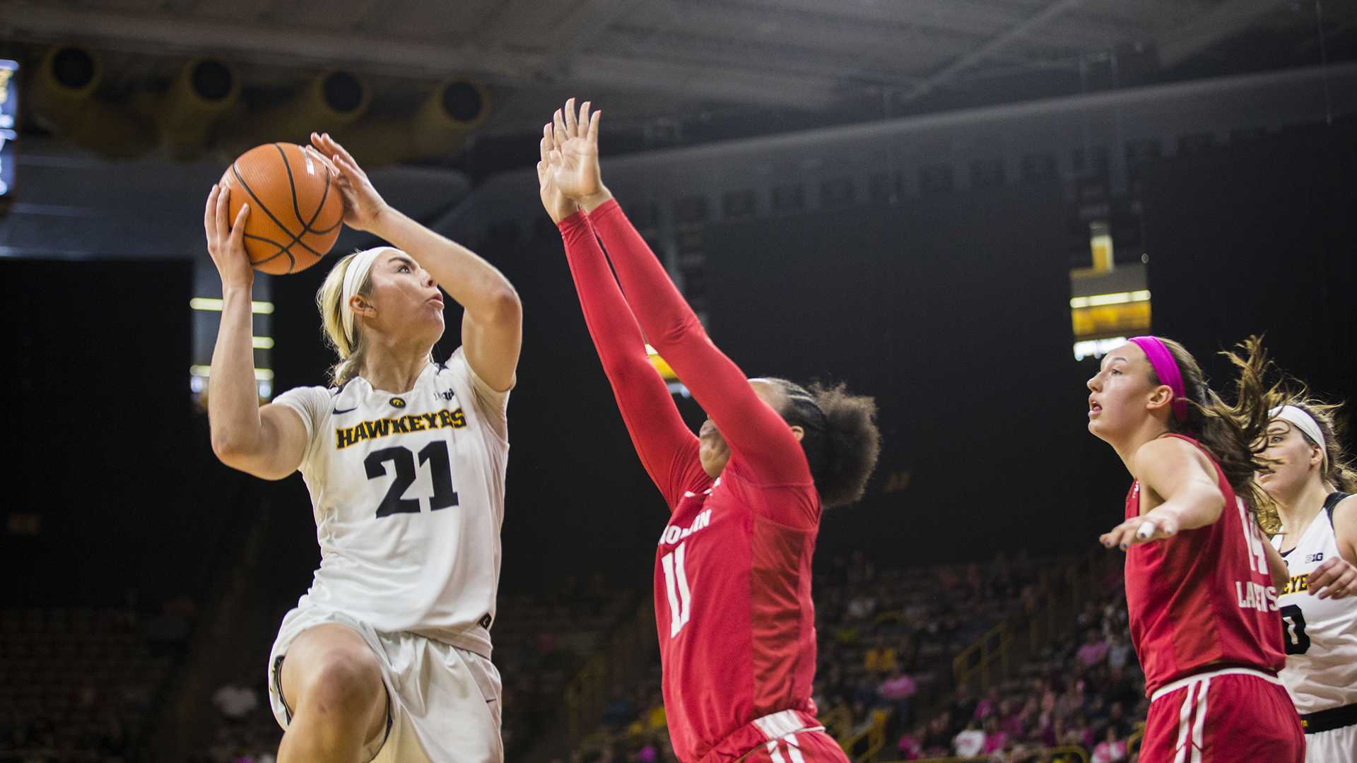 Iowa forward Hannah Stewart attempts a shot during the Iowa/Wisconsin basketball game at Carver-Hawkeye Arena on Sunday, Feb. 18, 2018. The Hawkeyes defeated the Badgers, 88-61. (Lily Smith/The Daily Iowan)