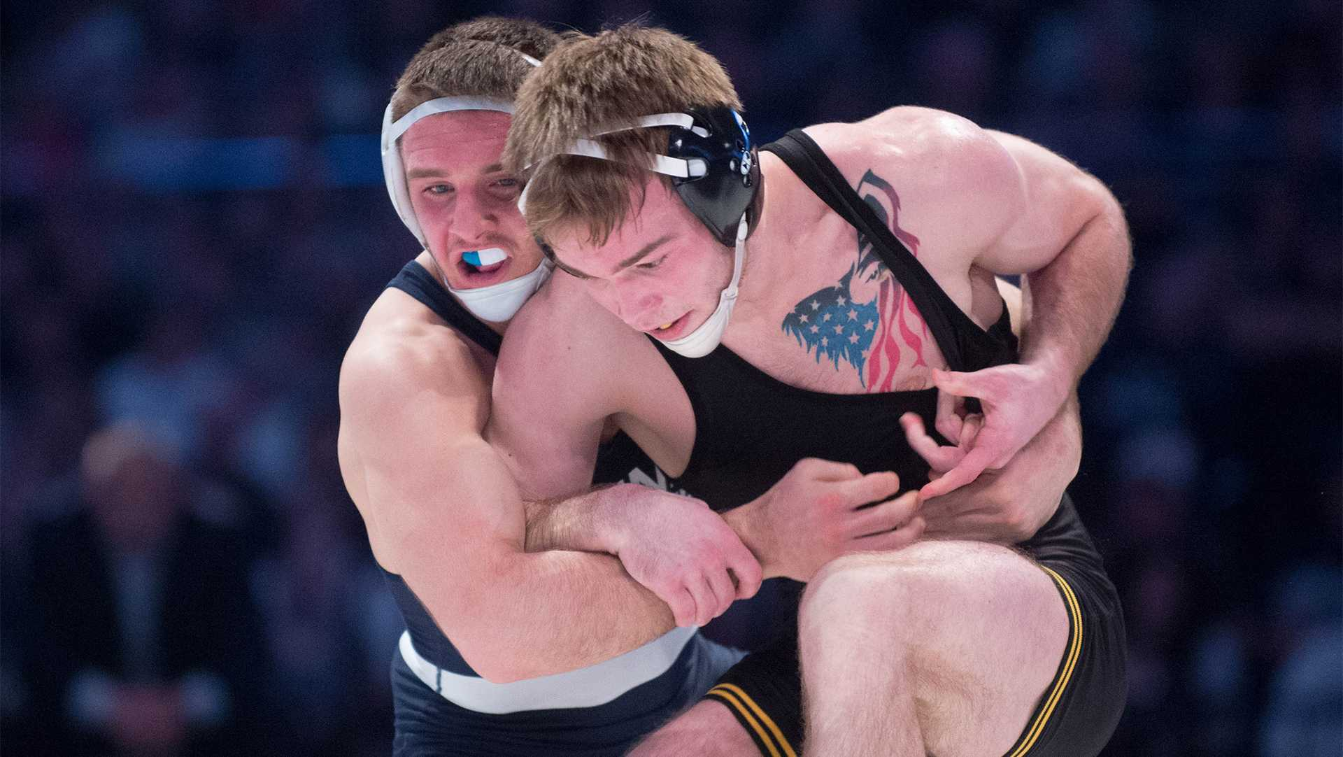 Penn State's Zain Retherford puts Iowa's Brandon Sorenson in a hold during the match at the Bryce Jordan Center on Satuday, Feb. 10.