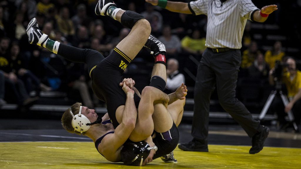Iowa%27s+%232+ranked+Michael+Kemerer+wrestles+Northwestern%27s+Shane+Oster+during+the+Iowa+vs.+Northwestern+dual+meet+on+Sunday%2C+Feb.+4%2C+2018.+Kemerer+won+a+tech+fall%2C+17-2.+The+Hawkeyes+defeated+the+wildcats+33-2.+%28Nick+Rohlman%2FThe+Daily+Iowan%29