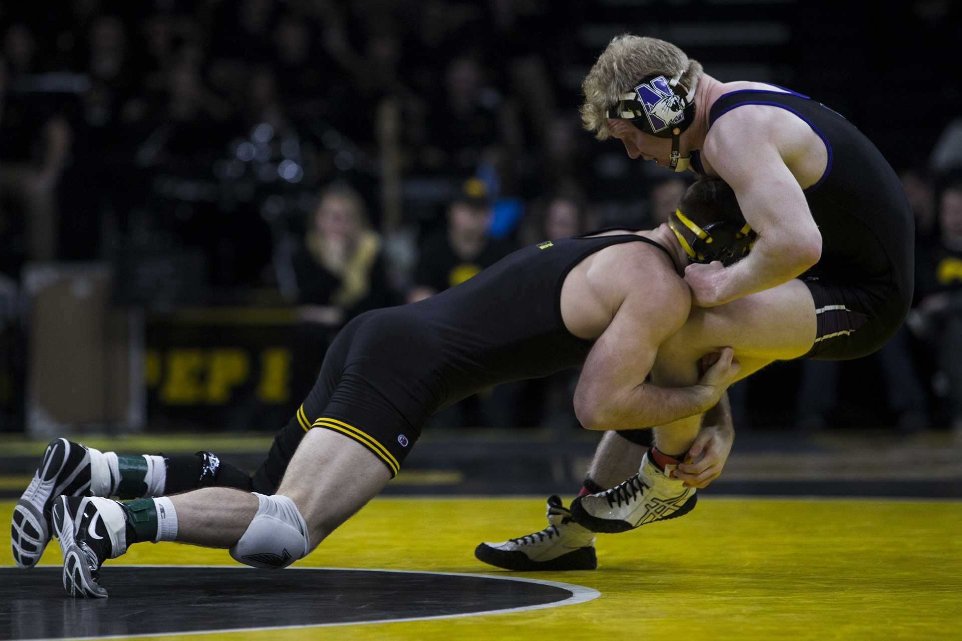 Iowa's #7 ranked 165 pound Alex Marinelli takes down Northwestern's Michael Sepke during the Iowa vs. Northwestern dual meet on Sunday, Feb. 4, 2018. The Hawkeyes defeated the Wildcats, 33-2. (Nick Rohlman/The Daily Iowan)