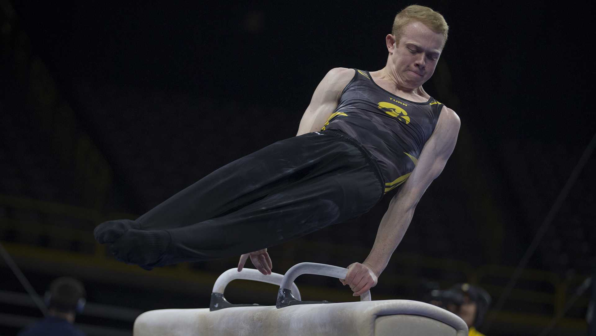 Nick Merryman competes on the pommel during men's gymnastics Iowa vs. Penn State and Arizona State on Mar. 3, 2018 at Carver Hawkeye Arena. Merryman earned 13.350 for his performance. The Hawkeyes defeated the Lions and the Sun Devils 404.050 to 396.550 and 376.150. (Katie Goodale/The Daily Iowan)