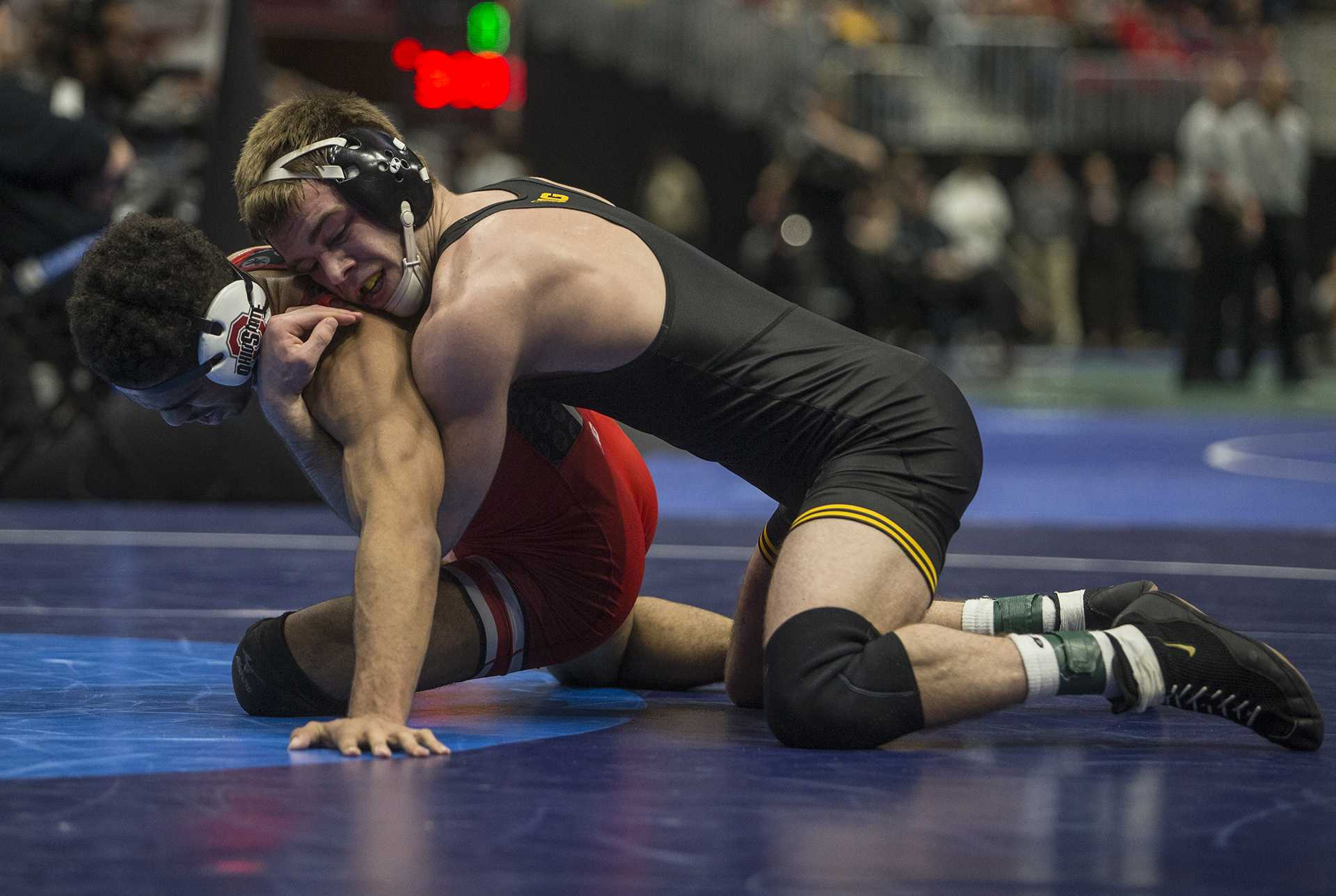 Iowa's 149-pound Brandon Sorensen competes against Ohio State's Ke-Shawn Hayes during Session 4 of the NCAAs Wrestling Championships at Quicken Loans Arena in Cleveland, OH on Thursday, March 16, 2018. Sorensen defeated Hayes by major decision 9-0. (Ben Allan Smith/The Daily Iowan)