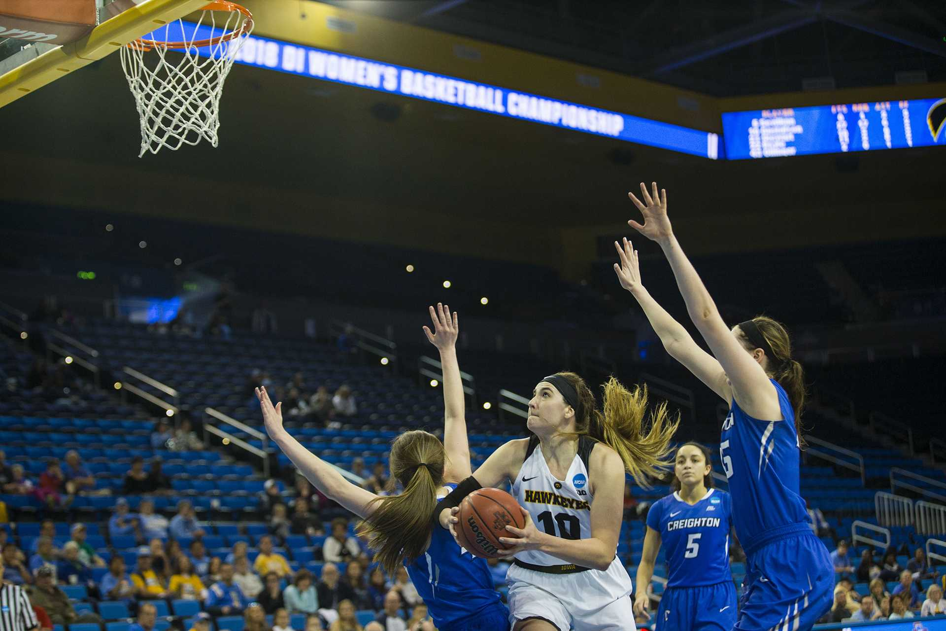 Iowa forward Megan Gustafson attempts a shot during the Iowa/Creighton NCAA tournament first round basketball game at Pauley Pavilion on UCLA's campus in Los Angeles on Saturday, March 17, 2018. The Bluejays defeated the Hawkeyes, 76-70. (Lily Smith/The Daily Iowan)