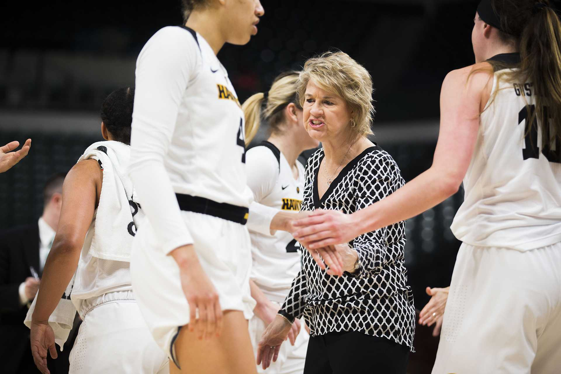 Iowa head coach Lisa Bluder talks to players during the Iowa/Northwestern Big Ten tournament basketball game at Bankers Life Fieldhouse in Indianapolis on Thursday, March, 1, 2018. The Hawkeyes defeated the Wildcats, 55-45. Iowa takes on No.4 Minnesota on Friday. (Lily Smith/The Daily Iowan)