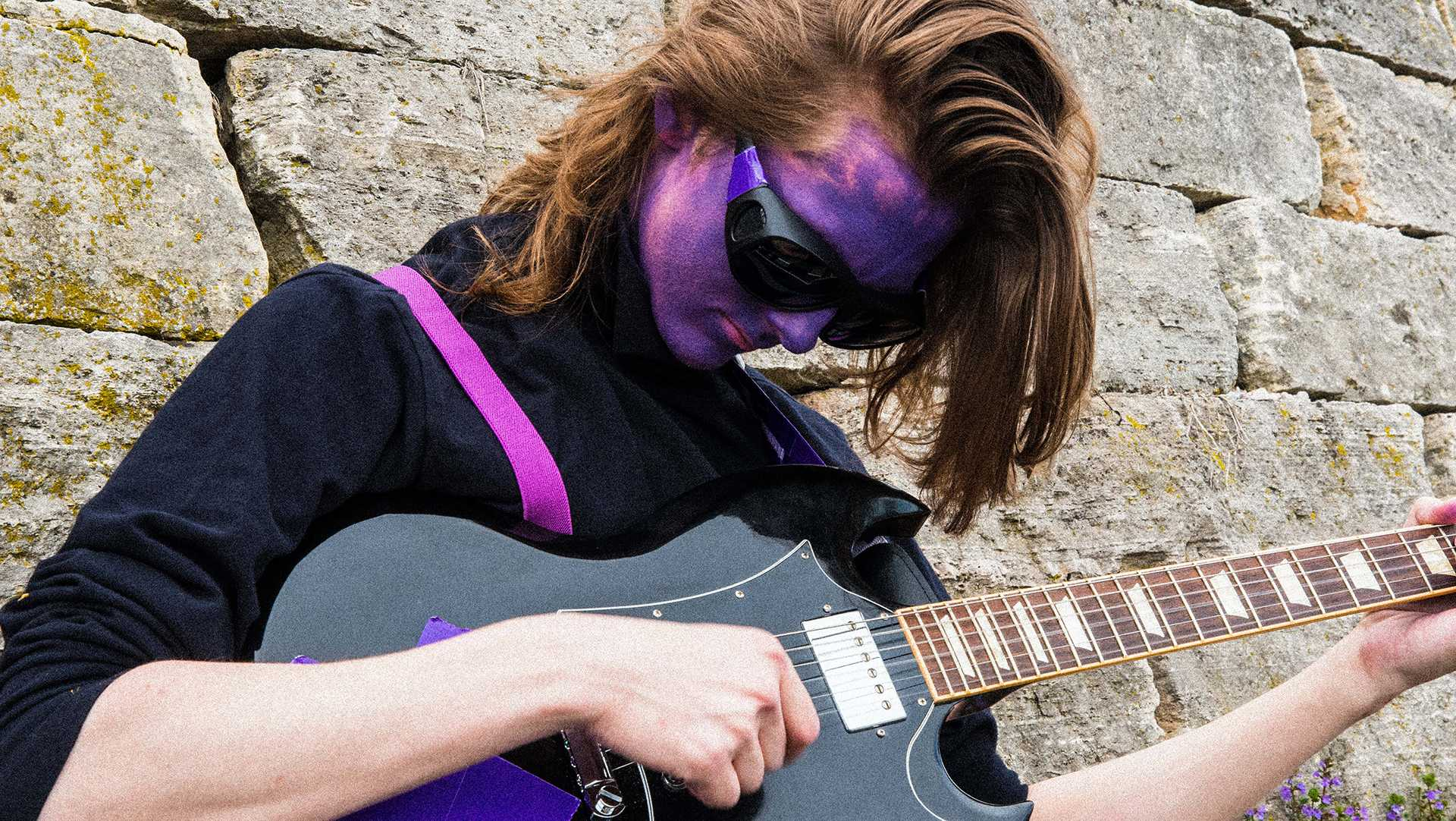 UI student trades textbooks for a guitar as Purple Frank