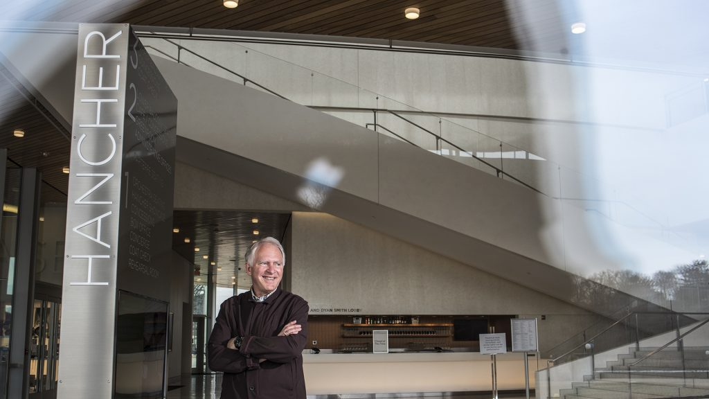 Chuck Swanson, Executive Director of Hancher Auditorium, stands inside the atrium of Hancher on Friday, Mar. 2, 2018. Swanson has been the Executive Director since 2002. (Ben Allan Smith/The Daily Iowan)