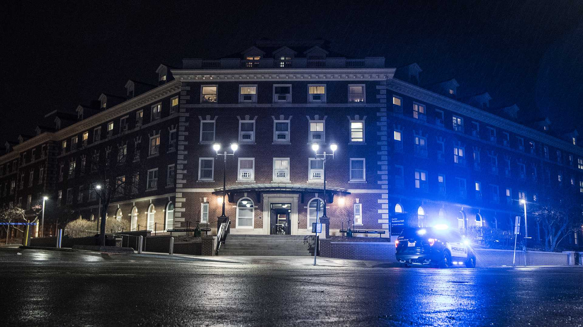 Iowa City and University of Iowa police respond to loud bangs at Currier Residence Hall on Wednesday, Feb. 28, 2018. No suspicious activity was reported by emergency services following an inspection of the building. (Ben Allan Smith/The Daily Iowan)