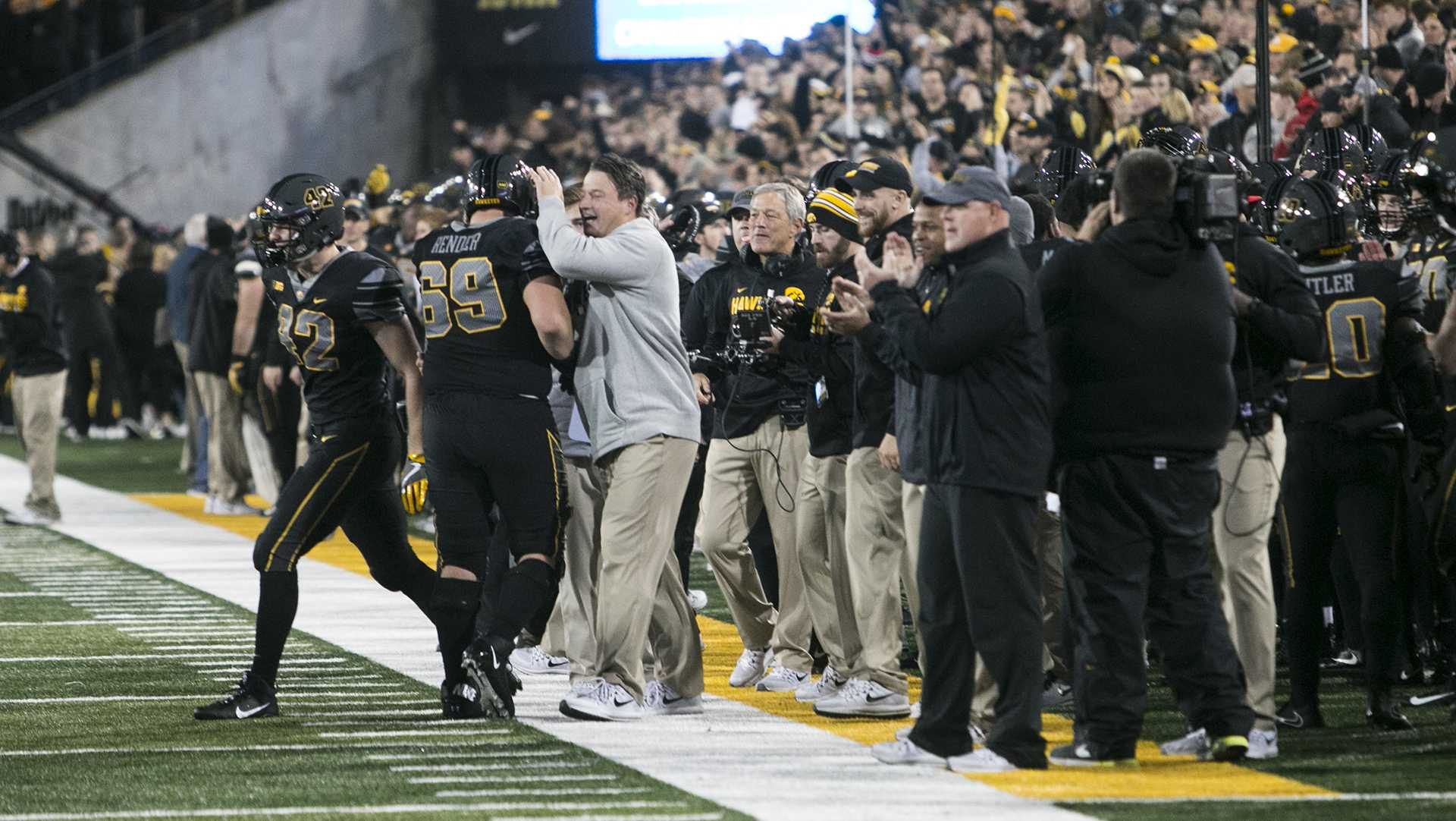 Iowa offensive coordinator Brian Ferentz celebrates with Keegan Render during the Iowa/Ohio State football game in Kinnick Stadium on Saturday, Nov. 4, 2017. The Hawkeyes defeated the Buckeyes in a storming fashion, 55-24. (Joseph Cress/The Daily Iowan)