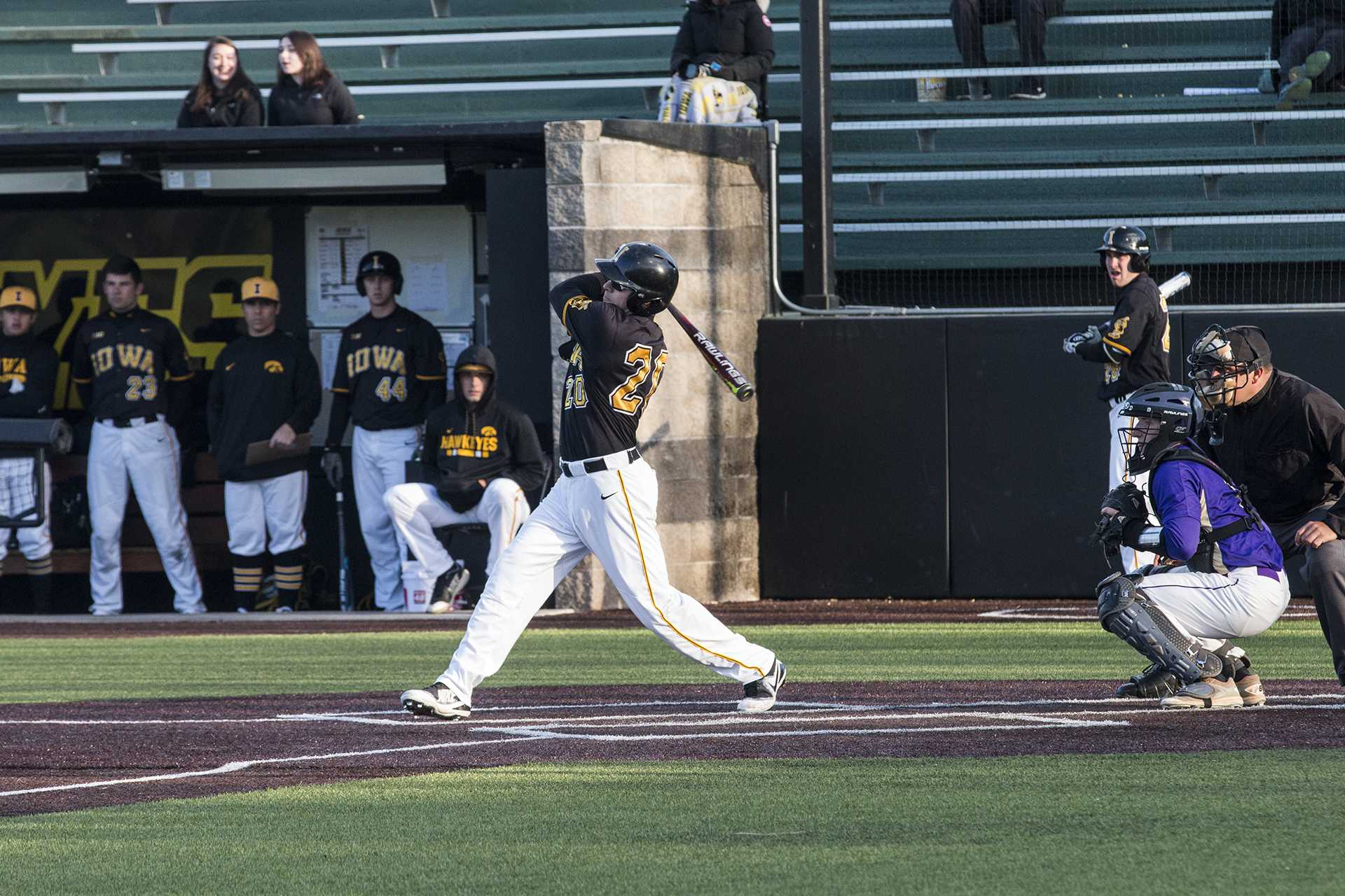 Iowa catcher Austin Guzzo swings at the pitch during men's baseball Iowa vs. Loras at Duane Banks Field on March 21, 2018. The Hawkeyes defeated the Duhawks 6-4. (Katina Zentz/The Daily Iowan) (Katina Zentz/Daily Iowan)