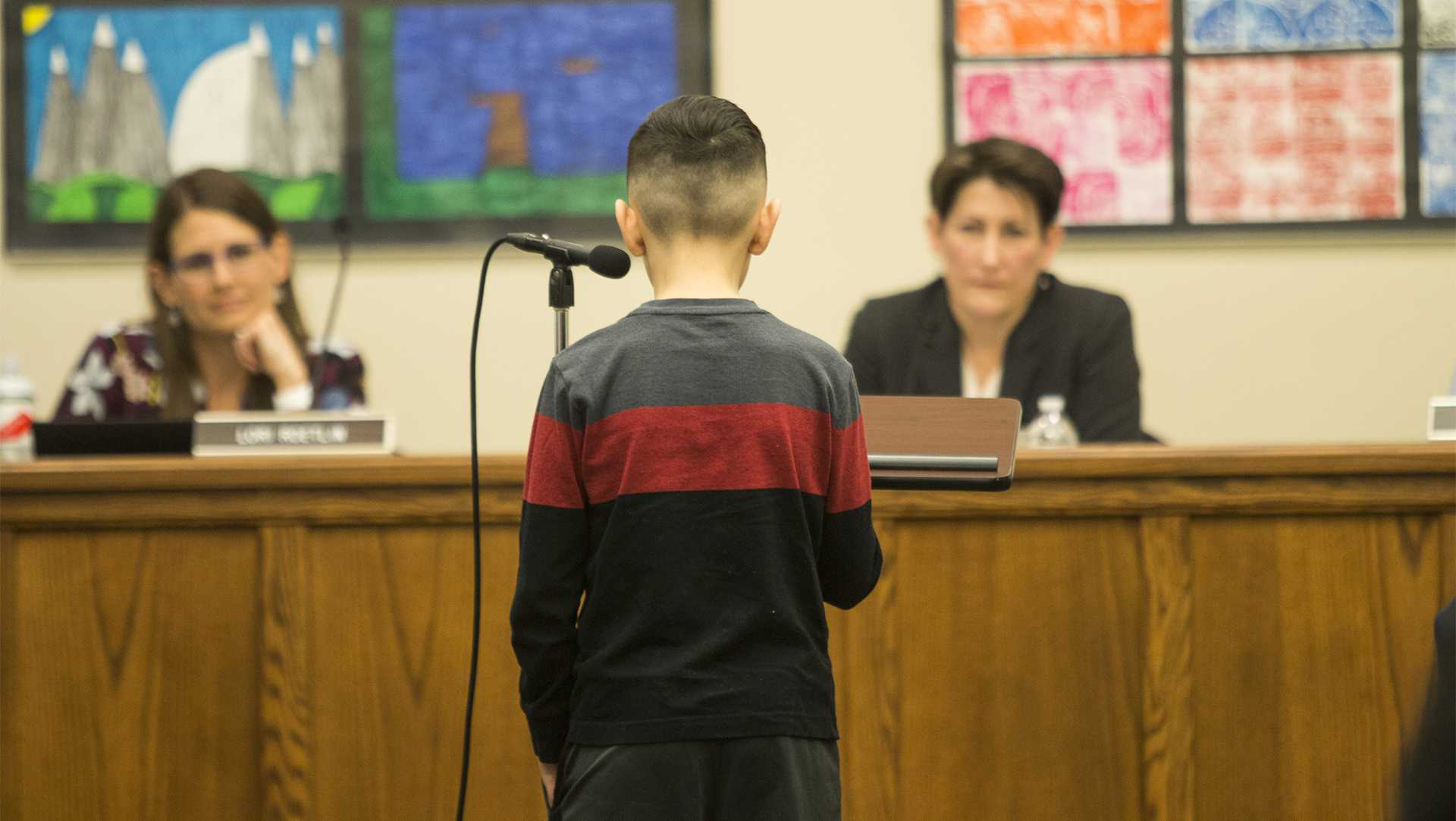A young attendee talks about his fear of school shootings during the Iowa City school board meeting at the Professional Development Center on March 27, 2018. Members of the school board discussed the possibility of creating a safety task force. (Katina Zentz/The Daily Iowan)