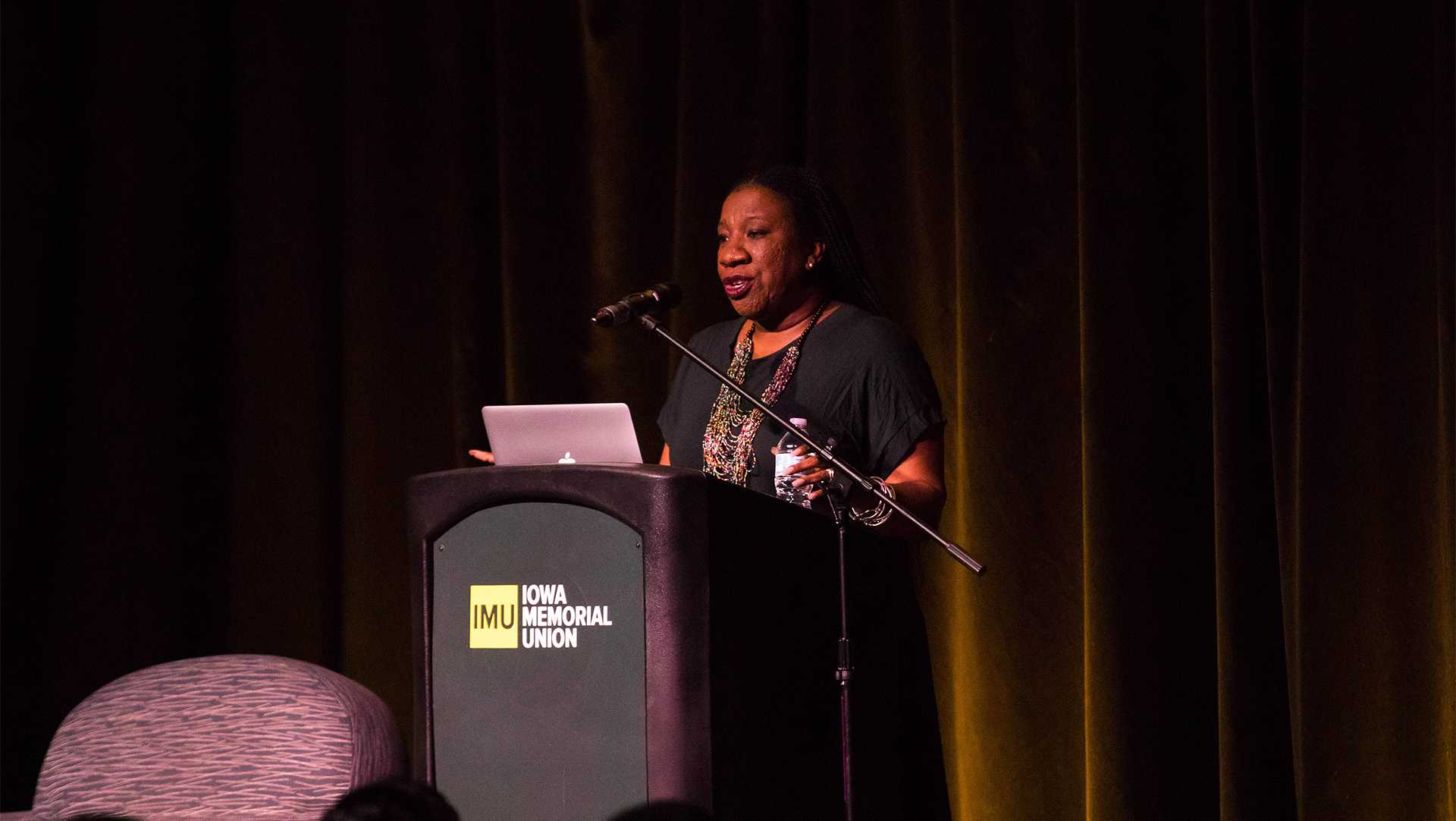 Tarana Burke, the founder of the #MeToo movement, speaks in the IMU on Tuesday. During the lecture, she spoke about her experiences regarding sexual assault and how she has advocated to stop abuse and help victims. (Megan Nagorzanski/Daily Iowan)