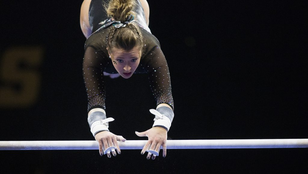 Iowa%27s+Maddie+Kampshroeder+performs+on+the+uneven+bars+during+the+Iowa%2FSoutheast+Missouri+State+gymnastics+meet+at+Carver-Hawkeye+Arena+on+Friday%2C+Mar.+02%2C+2018.+Kampshroeder+scored+a+9.775.+The+GymHawks+defeated+the+Redhawks%2C+195.550-192.750.+%28Katina+Zentz%2F+The+Daily+Iowan%29