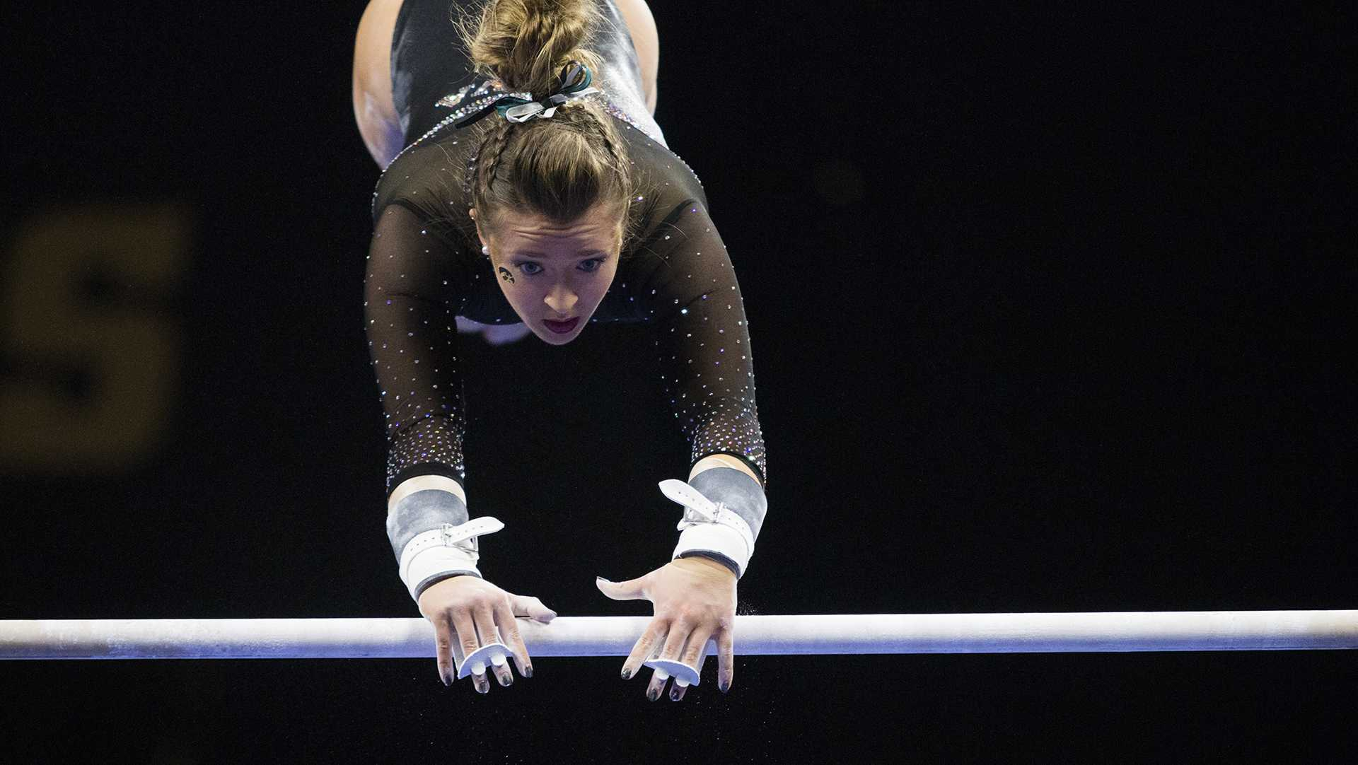 Iowa's Maddie Kampshroeder performs on the uneven bars during the Iowa/Southeast Missouri State gymnastics meet at Carver-Hawkeye Arena on Friday, Mar. 02, 2018. Kampshroeder scored a 9.775. The GymHawks defeated the Redhawks, 195.550-192.750. (Katina Zentz/ The Daily Iowan)
