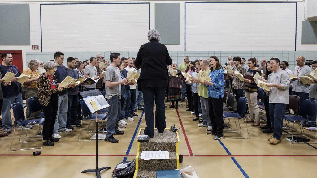 The+Oakdale+Community+Choir+rehearses+at+the+Iowa+Medical+and+Classification+Center+on+Tuesday%2C+March%2C+20%2C+2018.+The+choir+consists+of+both+inmates+and+outside+volunteers.+%28Nick+Rohlman%2FThe+Daily+Iowan%29