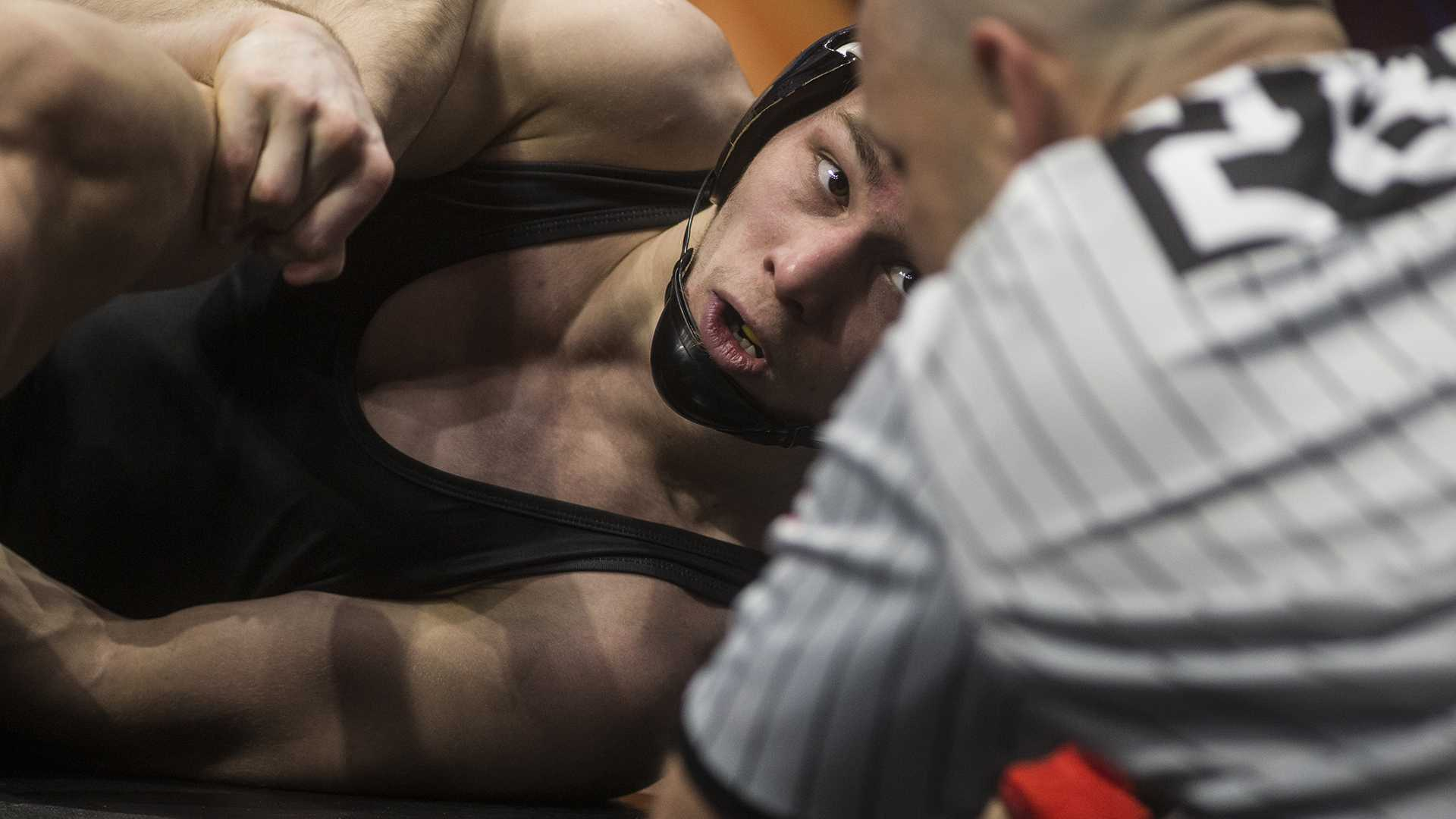 Iowa's 125-pound Spencer Lee looks to the ref during his match against Purdue's Luke Welch in Session 2 of the NCAA Division 1 Wrestling Championships at Quicken Loans Arena in Cleveland, Ohio on Thursday, March 15, 2018. Lee beat Welch by tech fall in 3:59. (Ben Allan Smith/The Daily Iowan)