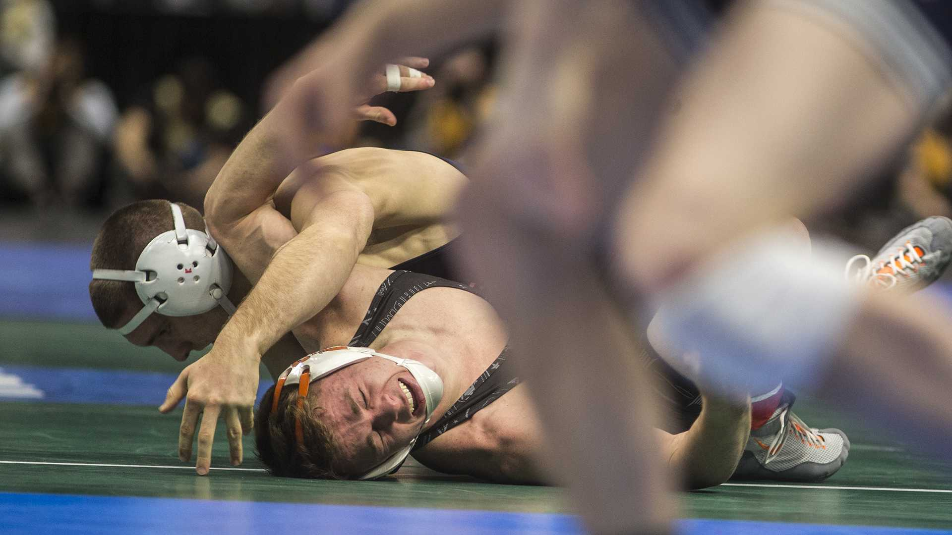 Penn State's Zain Retherford pins Oklahoma State's Boo Lewallen during Session 3 of the NCAAs Wrestling Championships at Quicken Loans Arena in Cleveland, OH on Thursday, March 16, 2018. Retherford advanced to the semifinals where he'll face off against UNC's Troy Heilmann (Ben Allan Smith/The Daily Iowan)