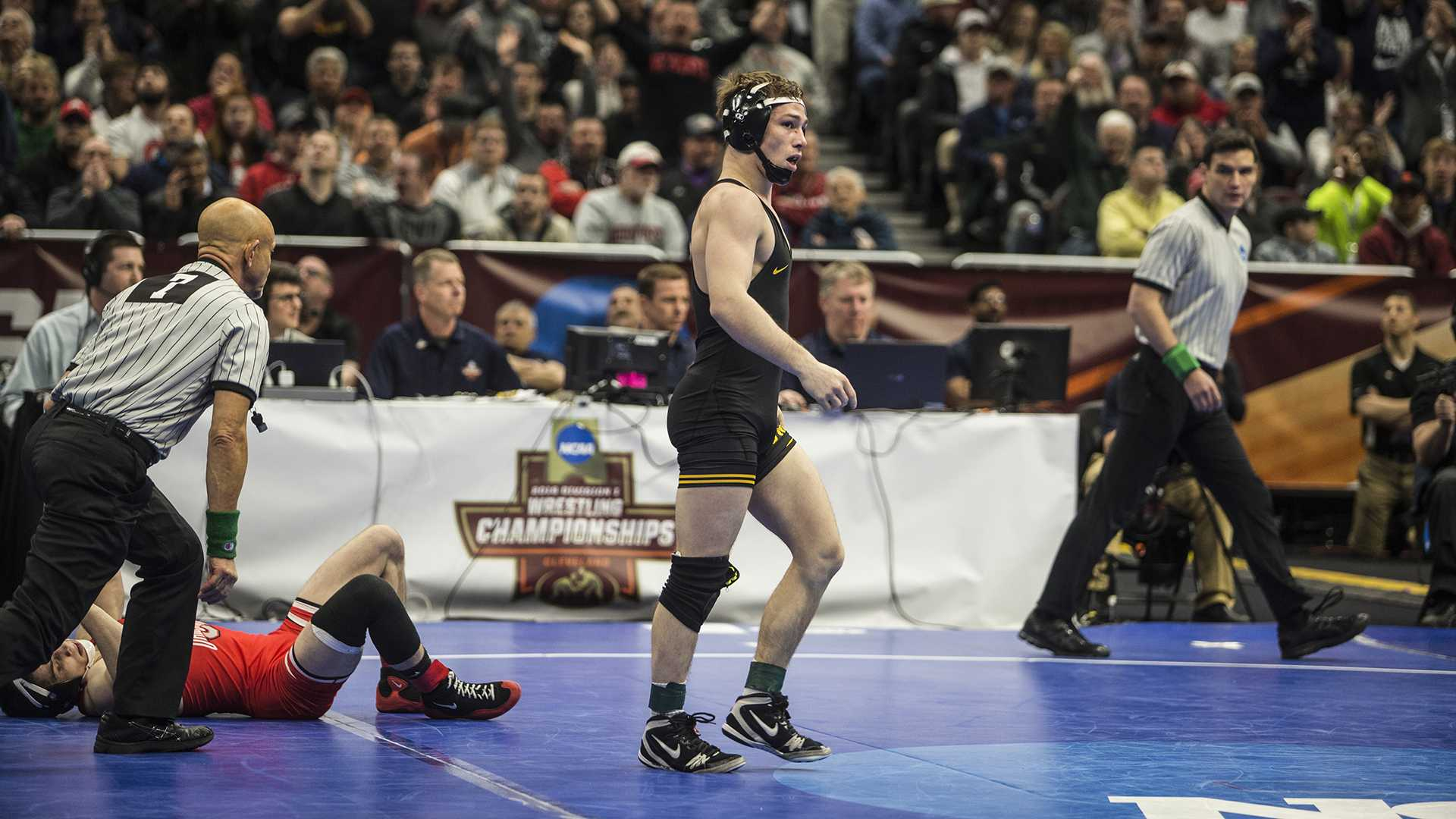 Iowa's 125-pound Spencer Lee defeats Ohio State's Nathan Tomasello in the semifinal bout of Session 4 of the NCAA Wrestling Championships at Quicken Loans Arena in Cleveland, OH on Thursday, March 16, 2018. Lee won by fall in 6:05. (Ben Allan Smith/The Daily Iowan)