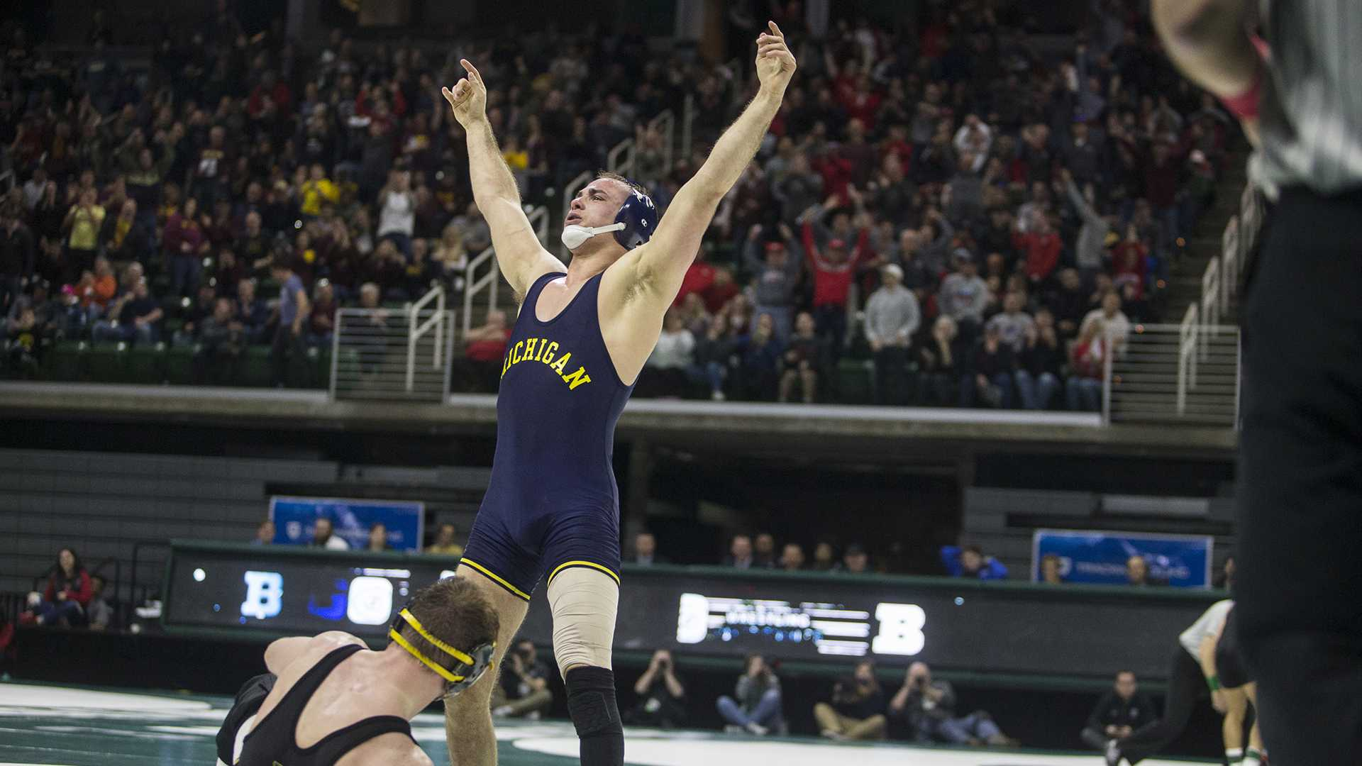 Michigan's 165-pound Logan Massa celebrates a victory over Iowa's Alex Marinelli during Big Ten Wrestling Championships Day 1 at the Breslin Student Events Center in East Lansing, MI on Saturday, Mar. 3, 2018. (Ben Allan Smith/The Daily Iowan)