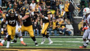Iowa quarterback Nate Stanley drops back to pass during the Iowa/Illinois football game on Saturday, 7 Oct. 2017. Iowa won the game 45-16. (David Harmantas/The Daily Iowan)