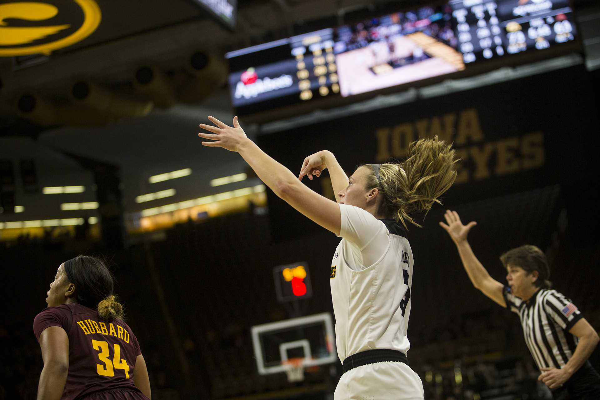 During the Iowa vs. Minnesota basketball game at Carver-Hawkeye Arena on Sunday, Feb. 4, 2018. The Hawkeyes defeated the Golden Gophers 92-84. Iowa Sophomore, Makenzie Meyer, drains a three pointer to increase the Hawkeyes lead at the end of the fourth quarter. (Chris Kalous/The Daily Iowan)