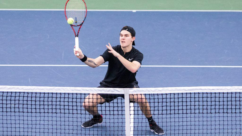 Iowa+tennis+player+Jonas+Larson++plays+at+the+net+during+a+doubles+match+against+Cornell+University+on+Friday%2C+Mar.+2%2C+2018.+The+Big+Red+defeated+the+Hawkeyes+4-3.+%28David+Harmantas%2FThe+Daily+Iowan%29
