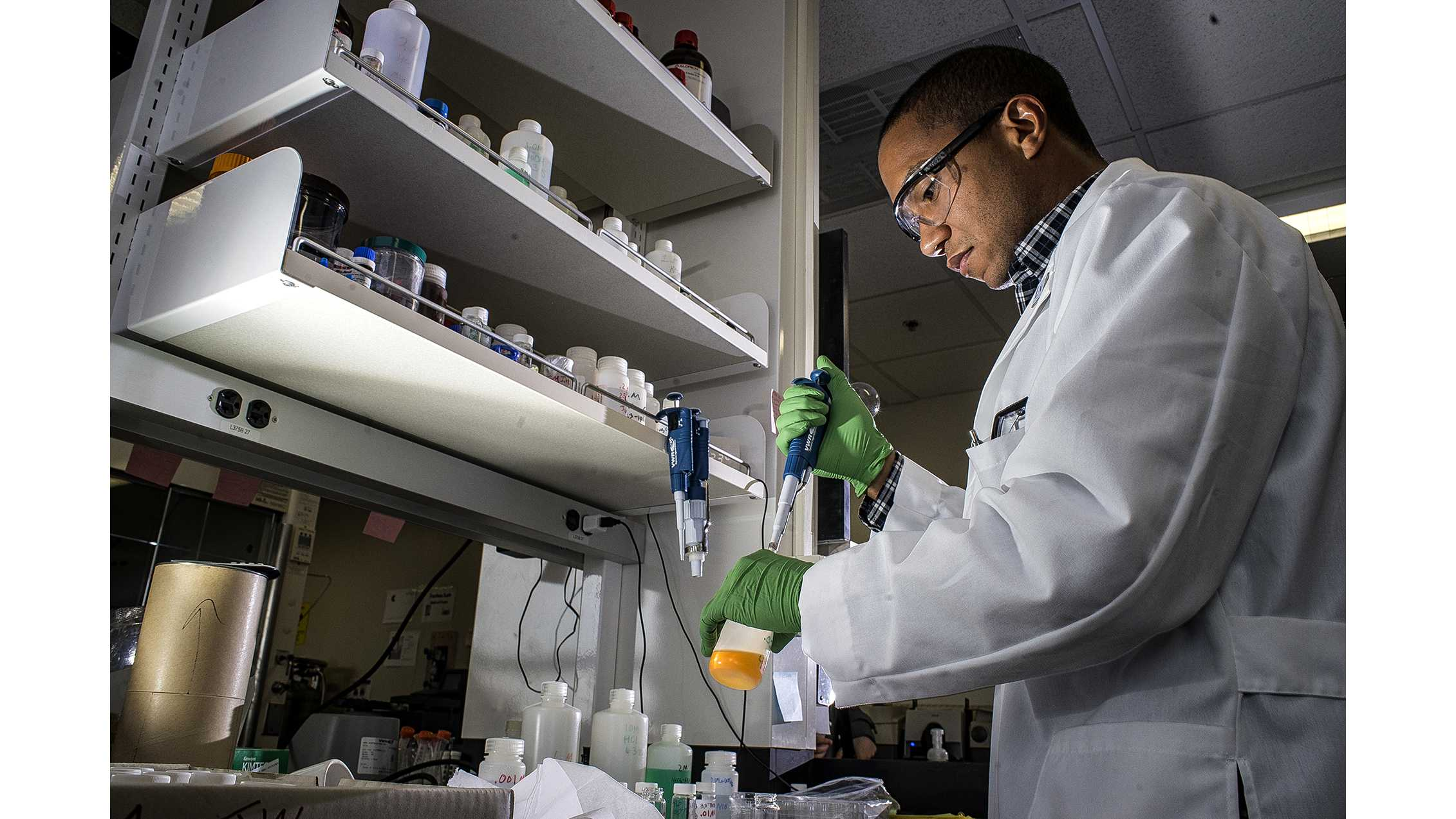 UI grad student, Mo Payne, prepares vials to stimulate uranium crystal growth in his laboratory on Wednesday, March 28, 2018. The research being conducted at the UI is focused on improving nuclear waste storage. (James Year/The Daily Iowan)