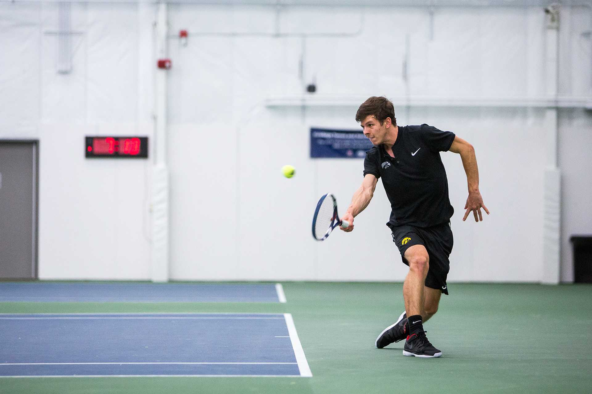 Iowa tennis player Piotr Smietana volleys the ball during a match against Cornell University on Friday, Mar. 2, 2018. Smietana lost his match 7-6 (7-4), 2-6, 6-4 and the Big Red defeated the Hawkeyes 4-3. (David Harmantas/The Daily Iowan)