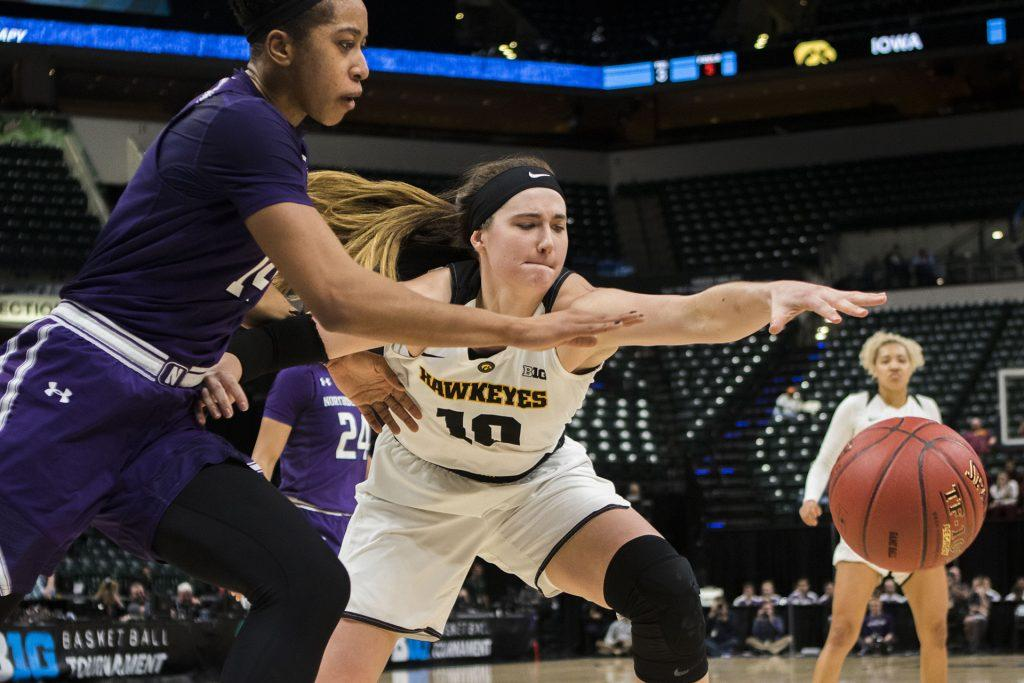 Iowa+forward+Megan+Gustafson+and+Northwestern+forward+Pallas+Kunaiya-Akpanah+attempt+to+take+control+of+the+ball+during+the+Iowa%2FNorthwestern+Big+Ten+tournament+basketball+game+at+Bankers+Life+Fieldhouse+in+Indianapolis+on+Thursday%2C+March%2C+1%2C+2018.+The+Hawkeyes+defeated+the+Wildcats%2C+55-45.+Iowa+takes+on+No.4+Minnesota+on+Friday.+%28Lily+Smith%2FThe+Daily+Iowan%29
