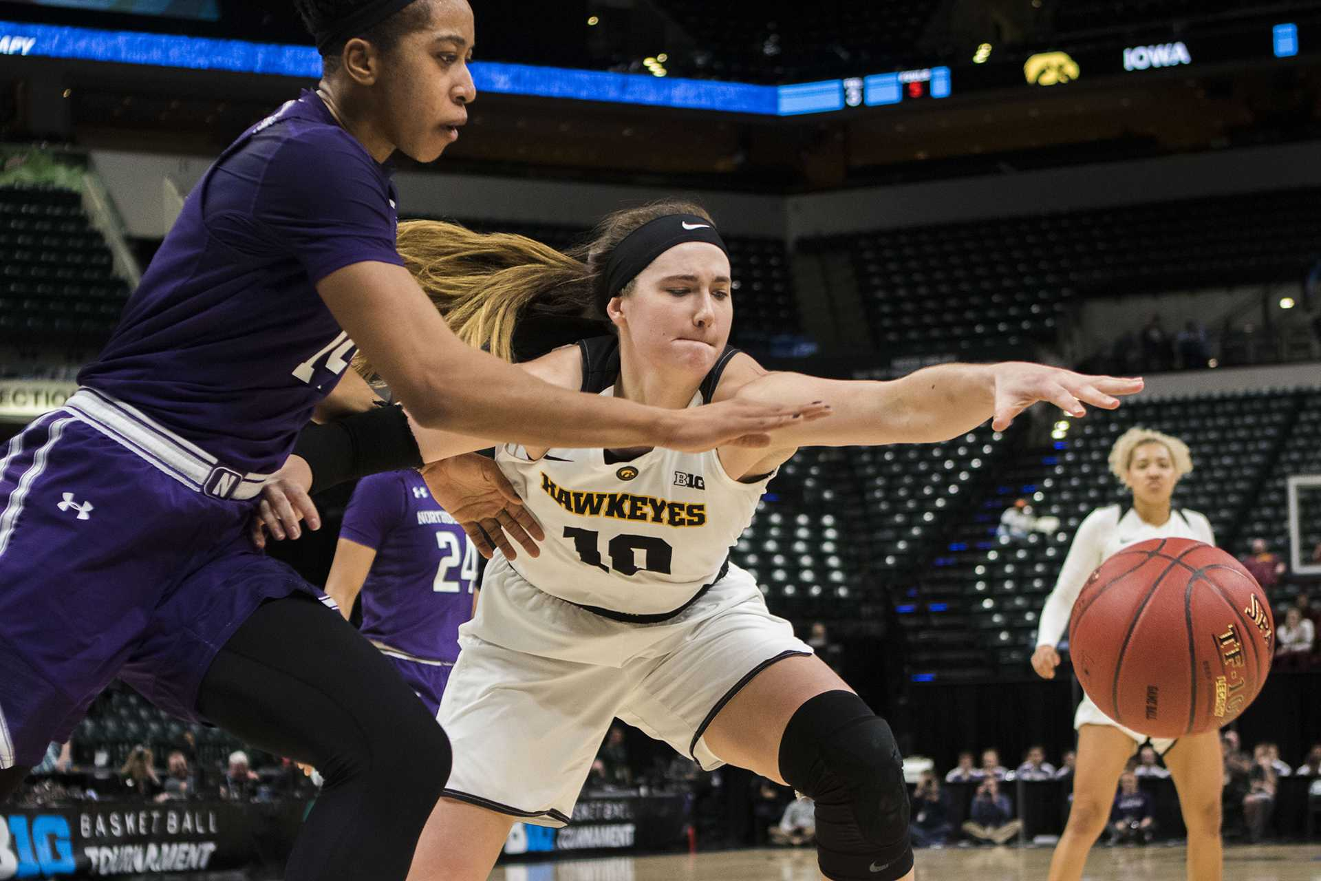 Iowa forward Megan Gustafson and Northwestern forward Pallas Kunaiya-Akpanah attempt to take control of the ball during the Iowa/Northwestern Big Ten tournament basketball game at Bankers Life Fieldhouse in Indianapolis on Thursday, March, 1, 2018. The Hawkeyes defeated the Wildcats, 55-45. Iowa takes on No.4 Minnesota on Friday. (Lily Smith/The Daily Iowan)