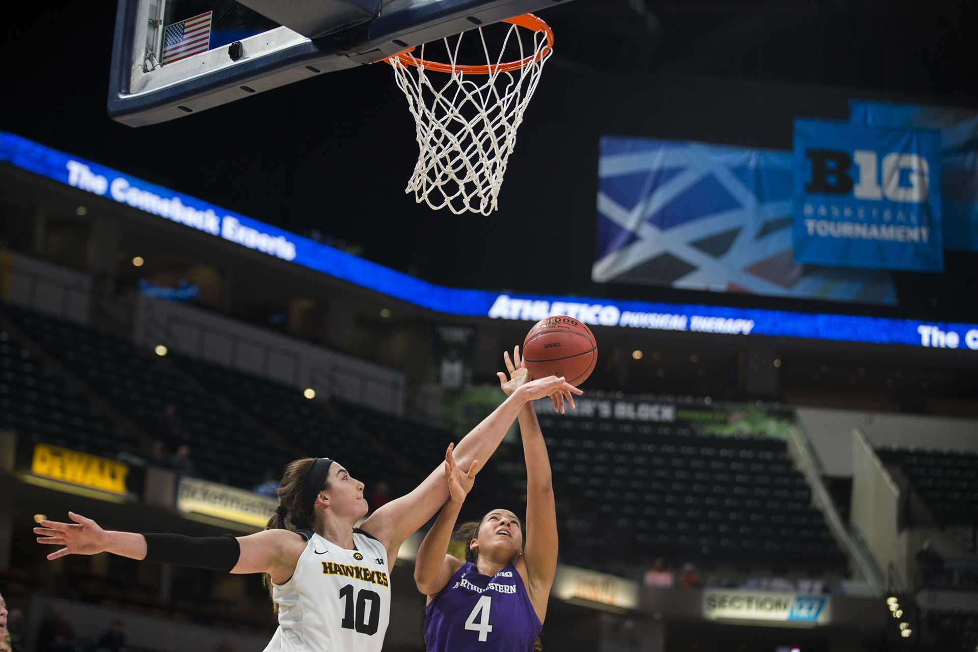 Iowa forward Megan Gustafson blocks a shot from Northwestern forward Bryana Hopkins during the Iowa/Northwestern Big Ten tournament basketball game at Bankers Life Fieldhouse in Indianapolis on Thursday, March, 1, 2018. The Hawkeyes defeated the Wildcats, 55-45. Iowa takes on No.4 Minnesota on Friday. (Lily Smith/The Daily Iowan)