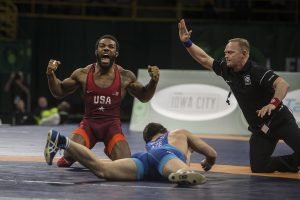 America's Jordan Burroughs (red) celebrates his victory over Gasjimurad Omarov (blue) of Azerbaijan at 74 kg during the final round of the 2018 Men's Freestyle World Cup at Carver-Hawkeye Arena on Saturday, April 7. Team USA placed first, defeating Azerbaijan 6-4 in the finals. (Ben Allan Smith/The Daily Iowan)