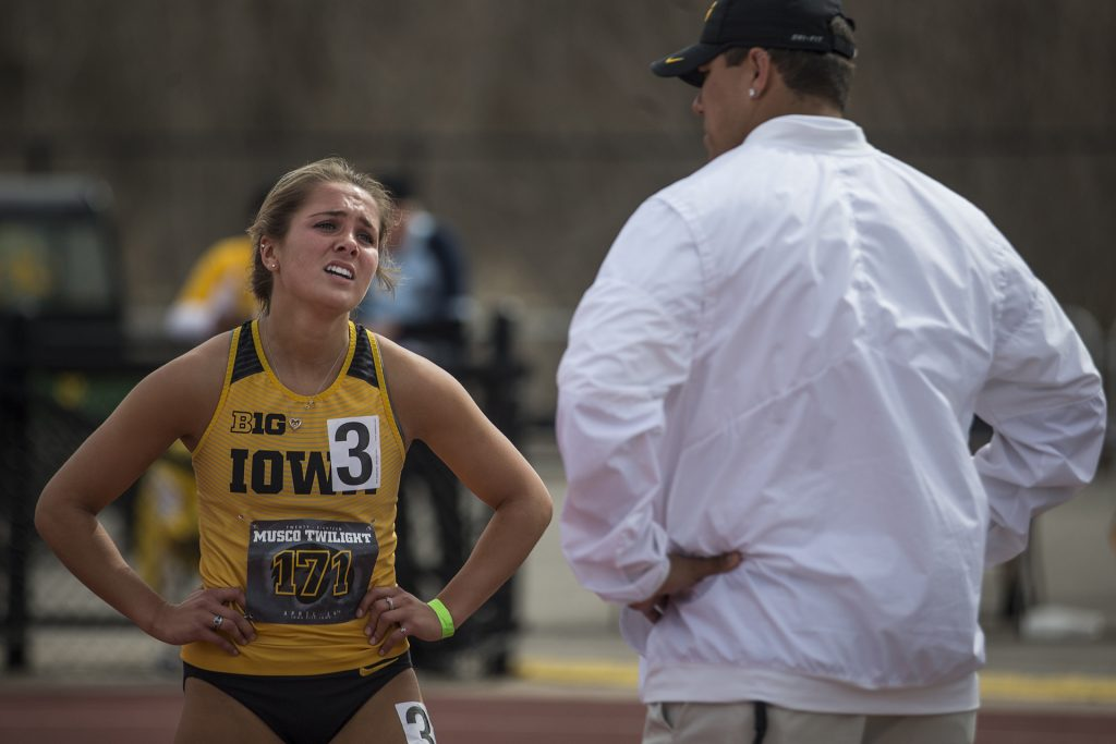 Iowa freshman Addie Swanson catches her breath after the women's 400 meter hurdles during the 19th annual Musco Twilight meet at the Francis X. Cretzmeyer Track in Iowa City on Thursday, April 12. Swanson finished third in the event with the time of 1:02.23. (Ben Allan Smith/The Daily Iowan)