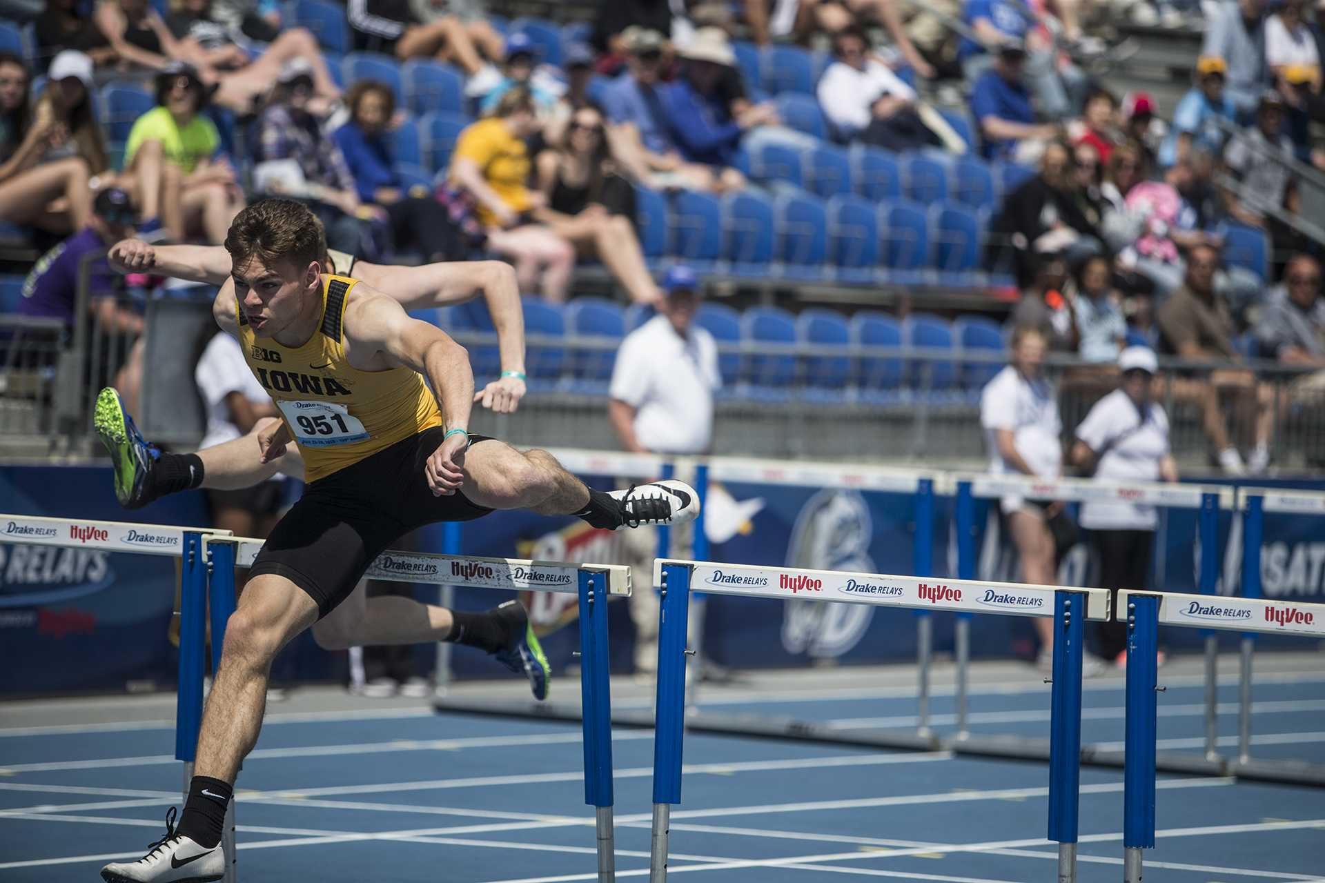Iowa's Chris Douglas, right, competes for first in the men's 110 meter hurdles during the 2018 Drake Relays at Drake Stadium in Des Moines, Iowa on Friday, April 27, 2018. Douglas finished first with a time of 14.03. (Ben Allan Smith/The Daily Iowan)