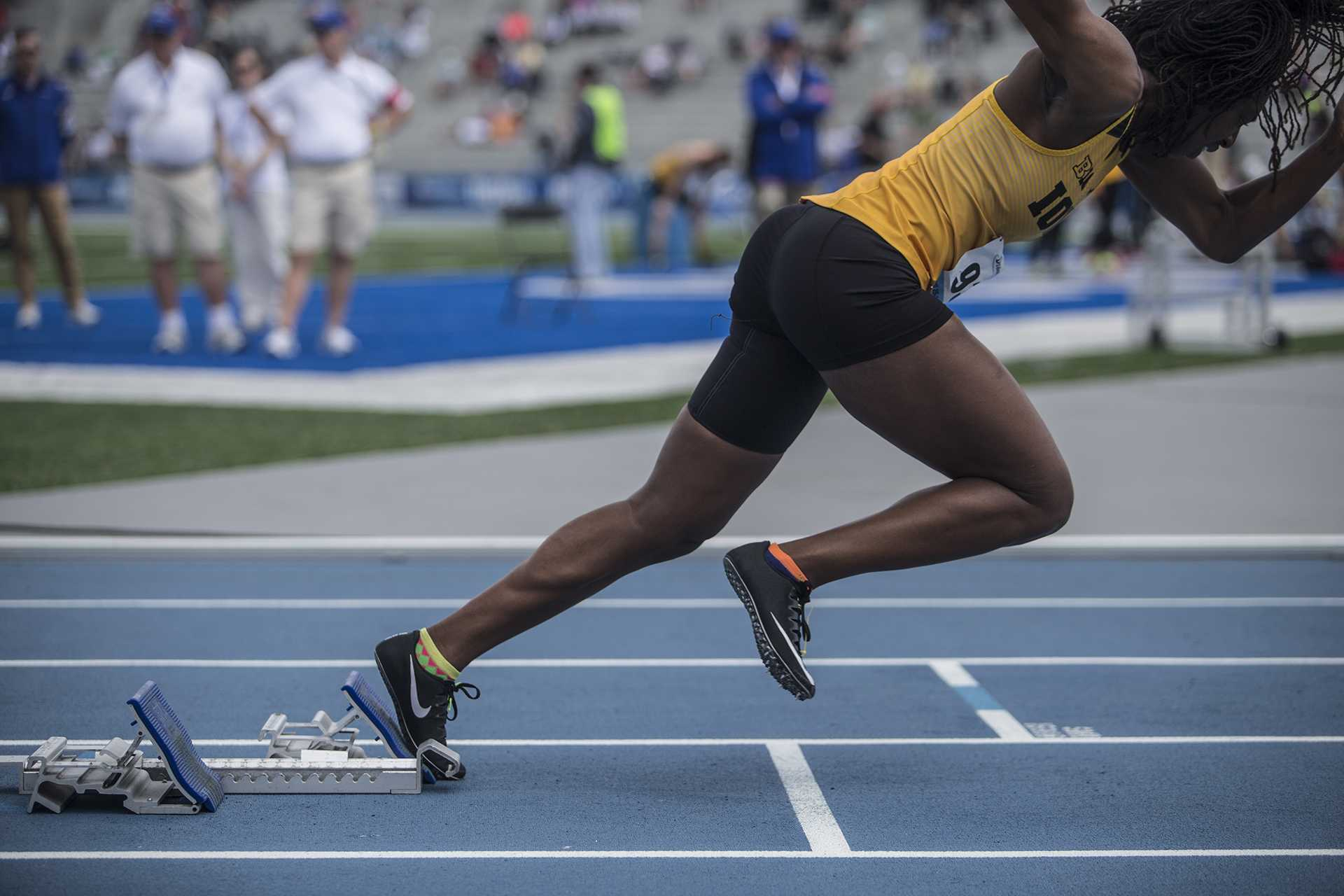 Iowa's Jahisha Thomas starts off the blocks during the womens' 4x100 meter relay in the 2018 Drake Relays at Drake Stadium in Des Moines, Iowa on Friday, April 27, 2018. Iowa finished second with a time of 45.58. (Ben Allan Smith/The Daily Iowan)